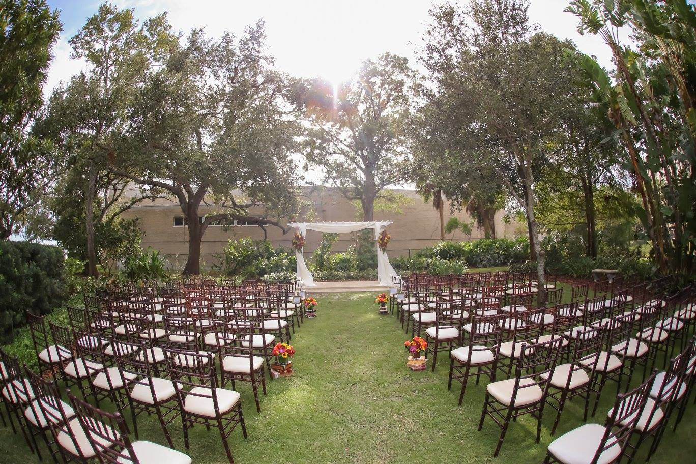 The Tampa Garden Club's lush garden space created the perfect ceremony backdrop as the two exchanged vows led by a close friend from the groom's residency program.