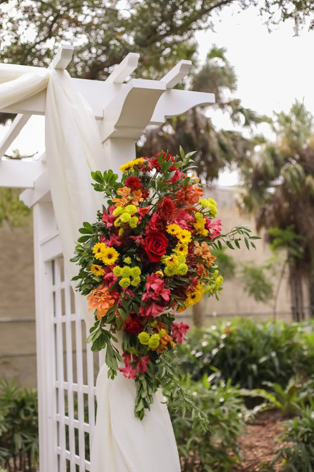 Colorful flora combined Fall colors with bright hues, resulting in arrangements that reflected the season as well as surprise tropical elements.