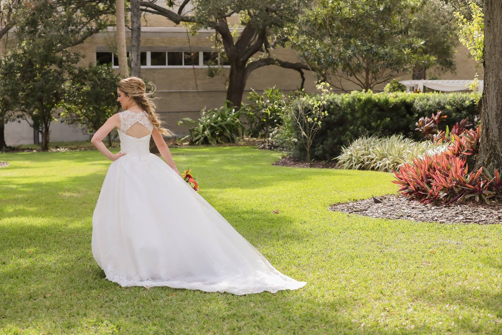 The bride truly looked like a princess in her lace ballgown with keyhole illusion lace detailing on the back.