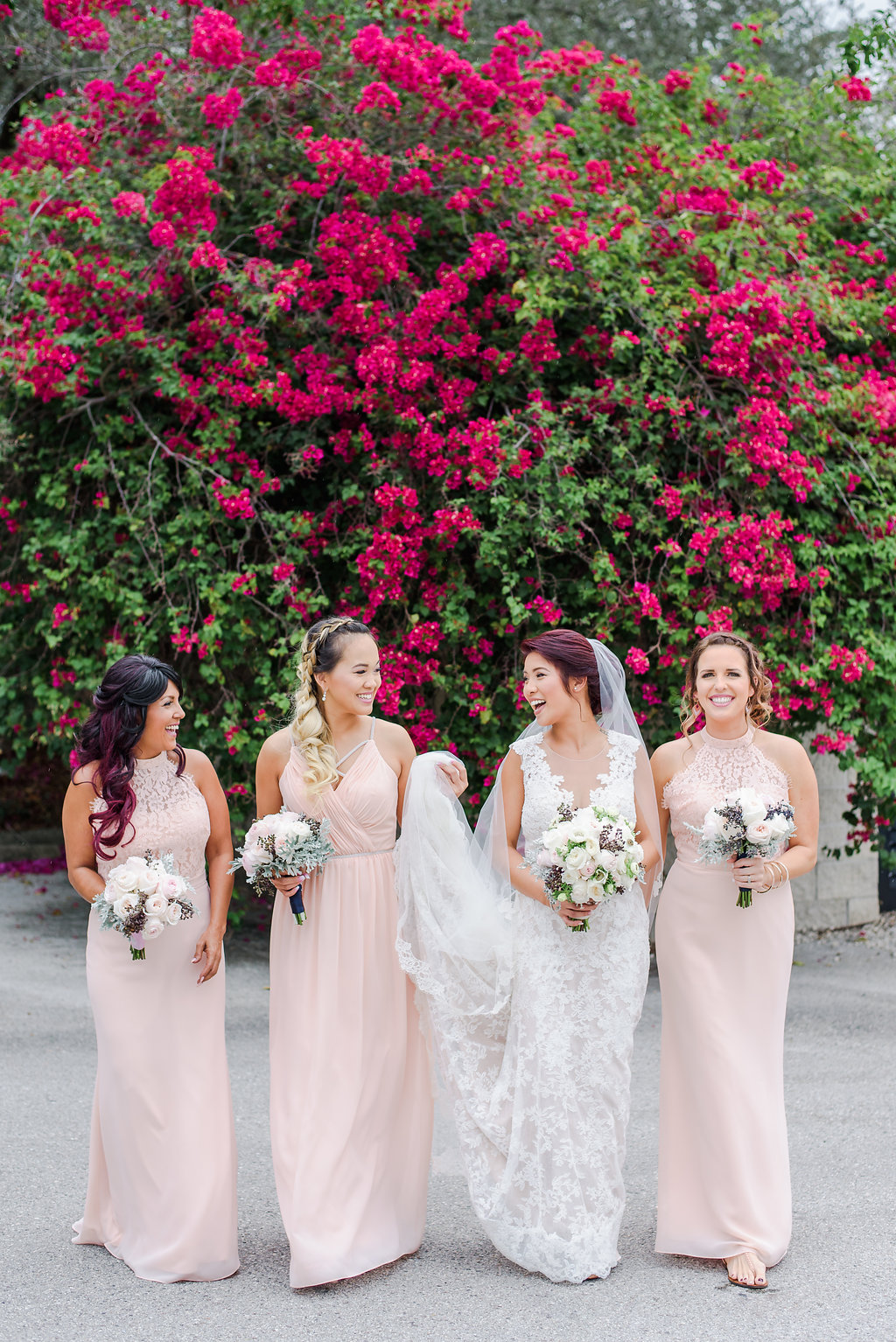 Bridesmaids wore blush chiffon dresses with lace accents.