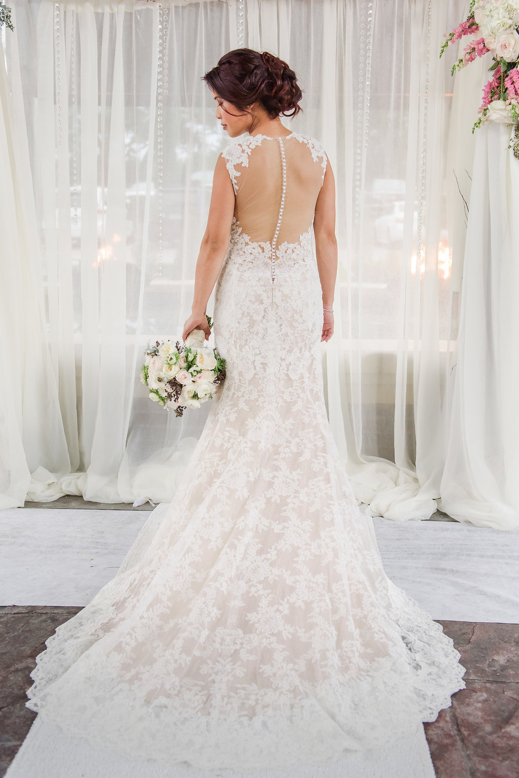 The bride wore a gorgeous lace mermaid style gown with sheer illusion back detailing.