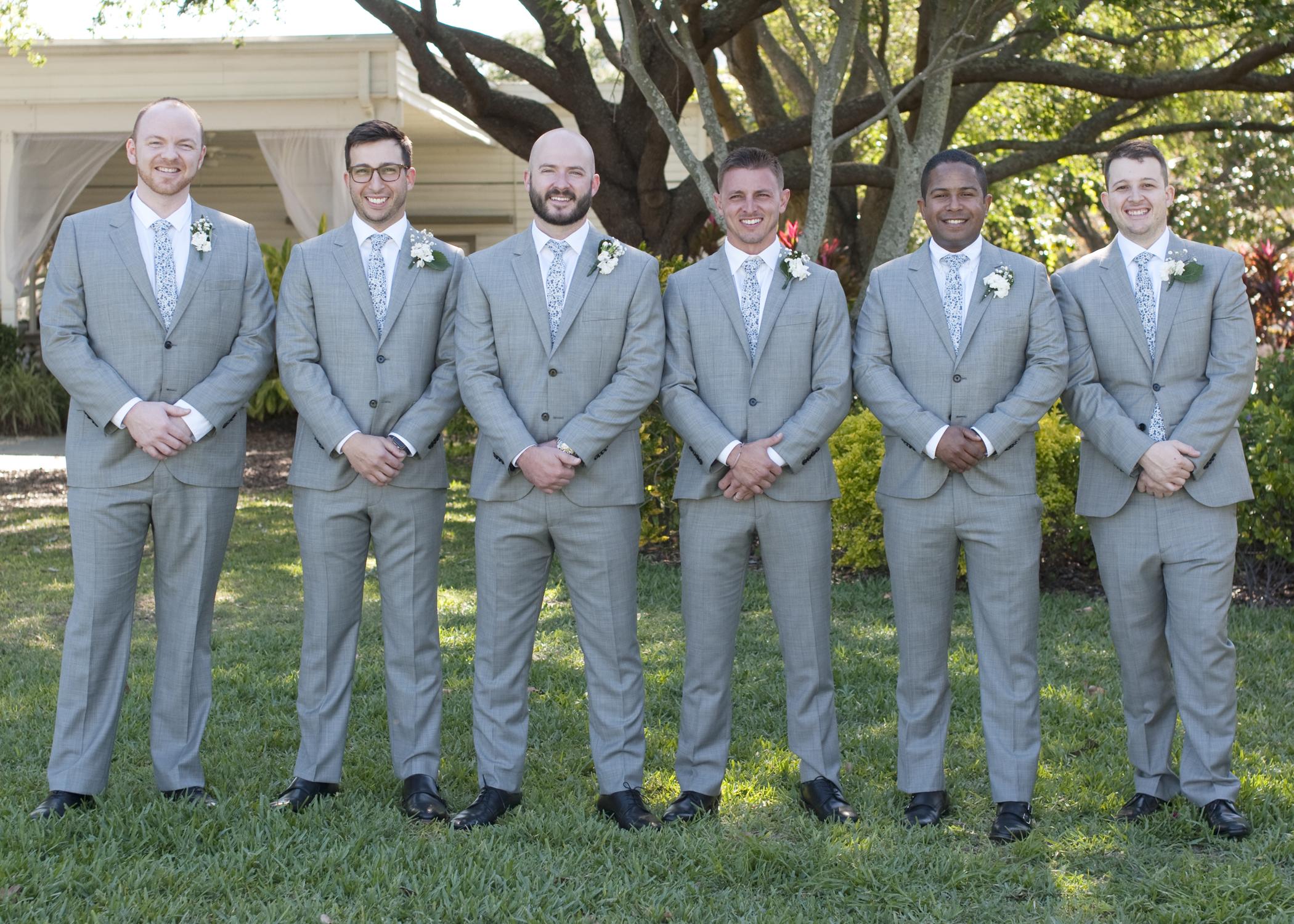 Gentlemen looked dapper in their crisp light grey suits.