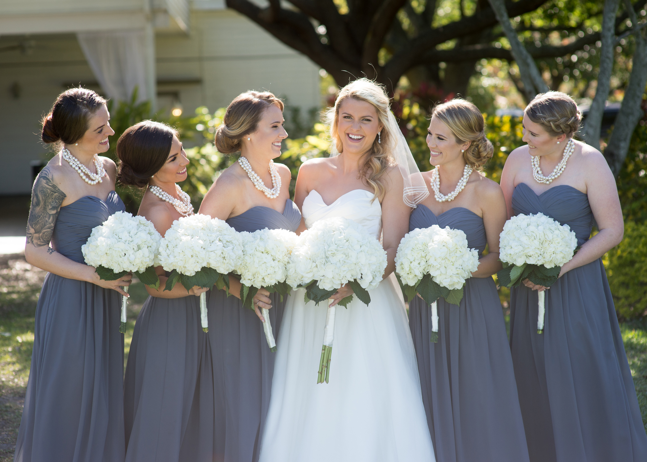 Fluffy hydrangea accented the reception tables and the bouquets.