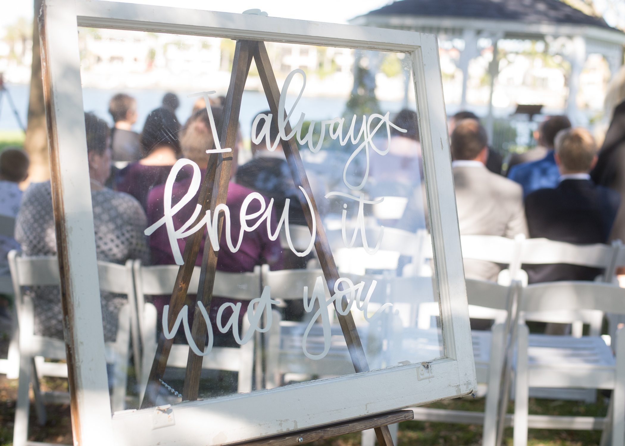 Sweet messages were hand written on vintage window panes and set around the ceremony space.