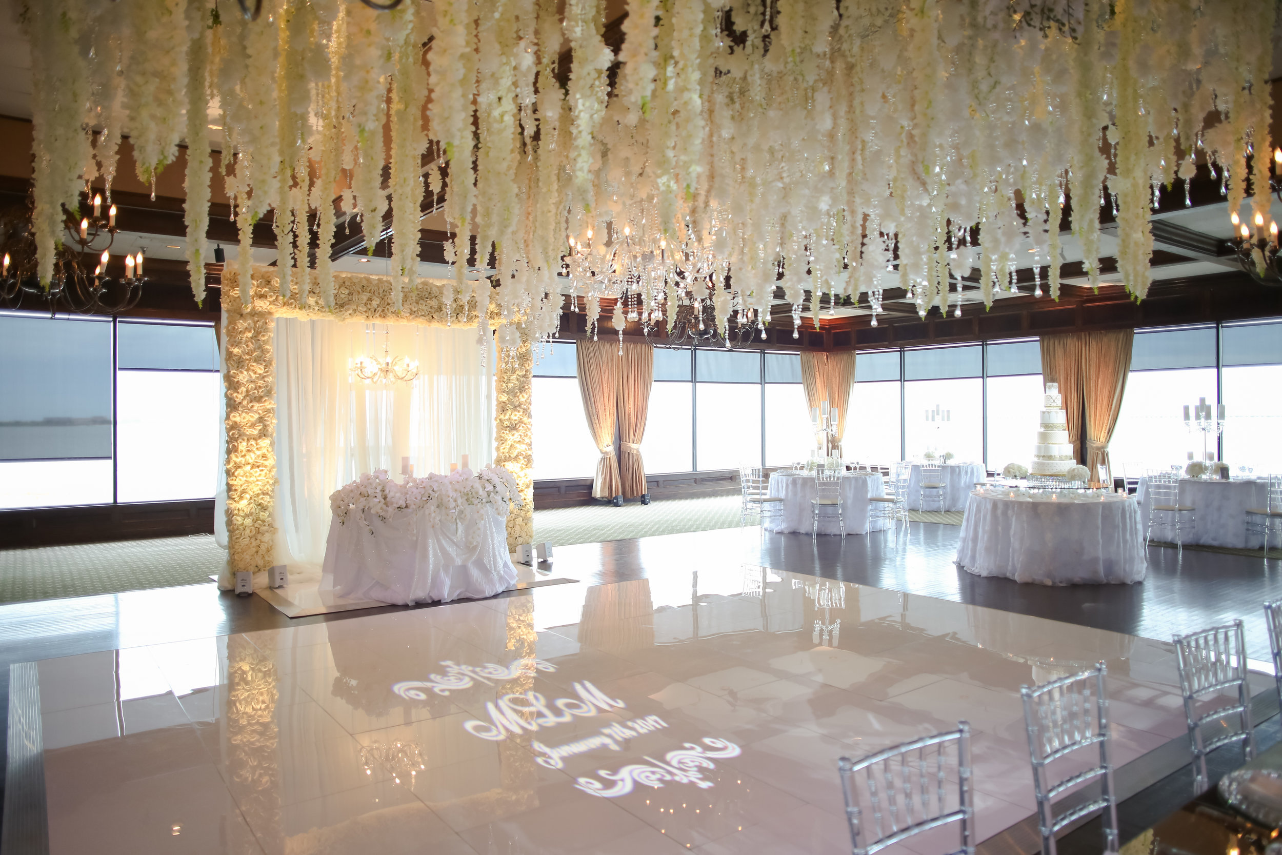 Inside the expansive ballroom, a floral ceiling installment was the jaw-dropping focal point above a white dance floor.