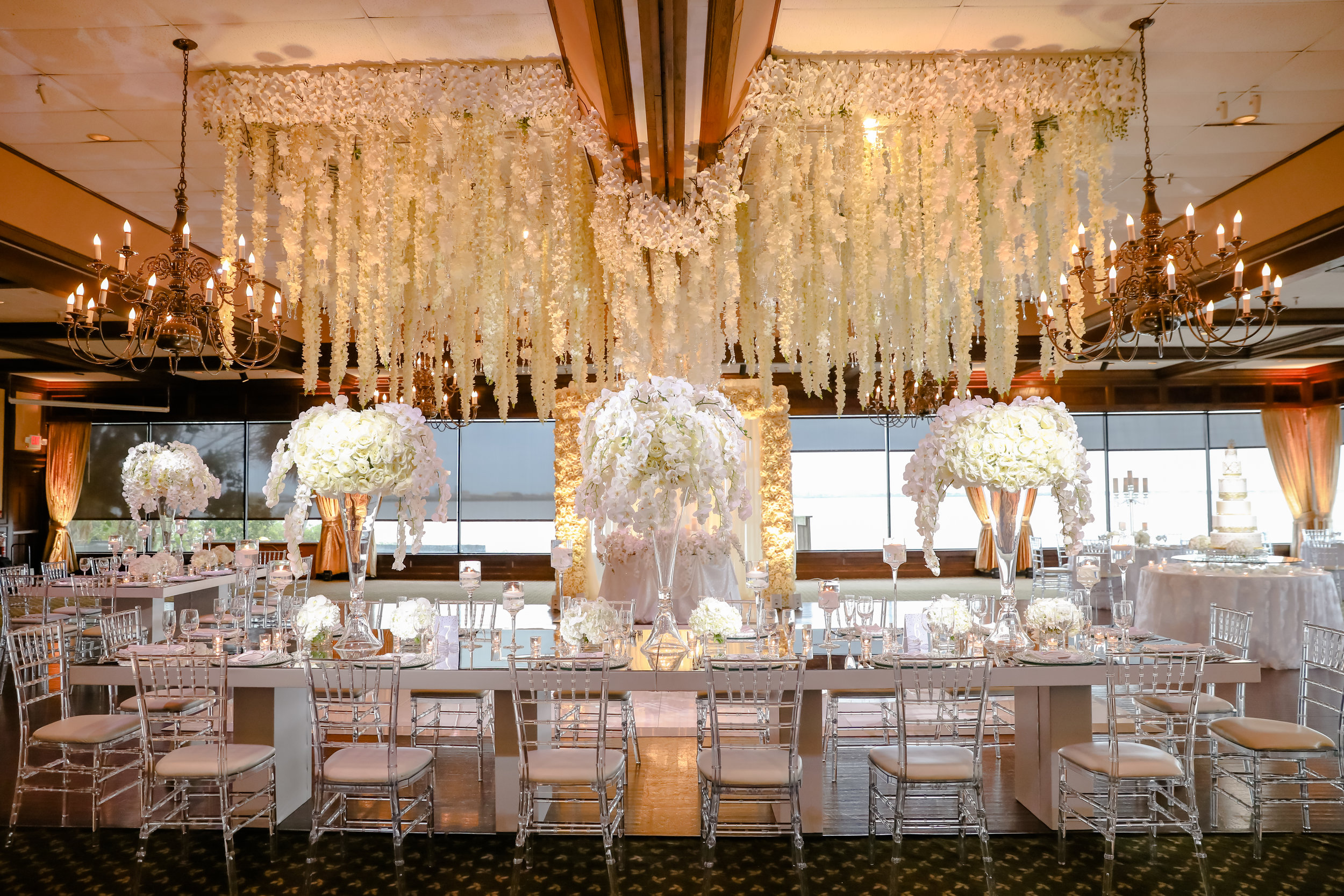 Crystal chiavari chairs and an abundance of lush florals helped create an elevated and elegant affair.