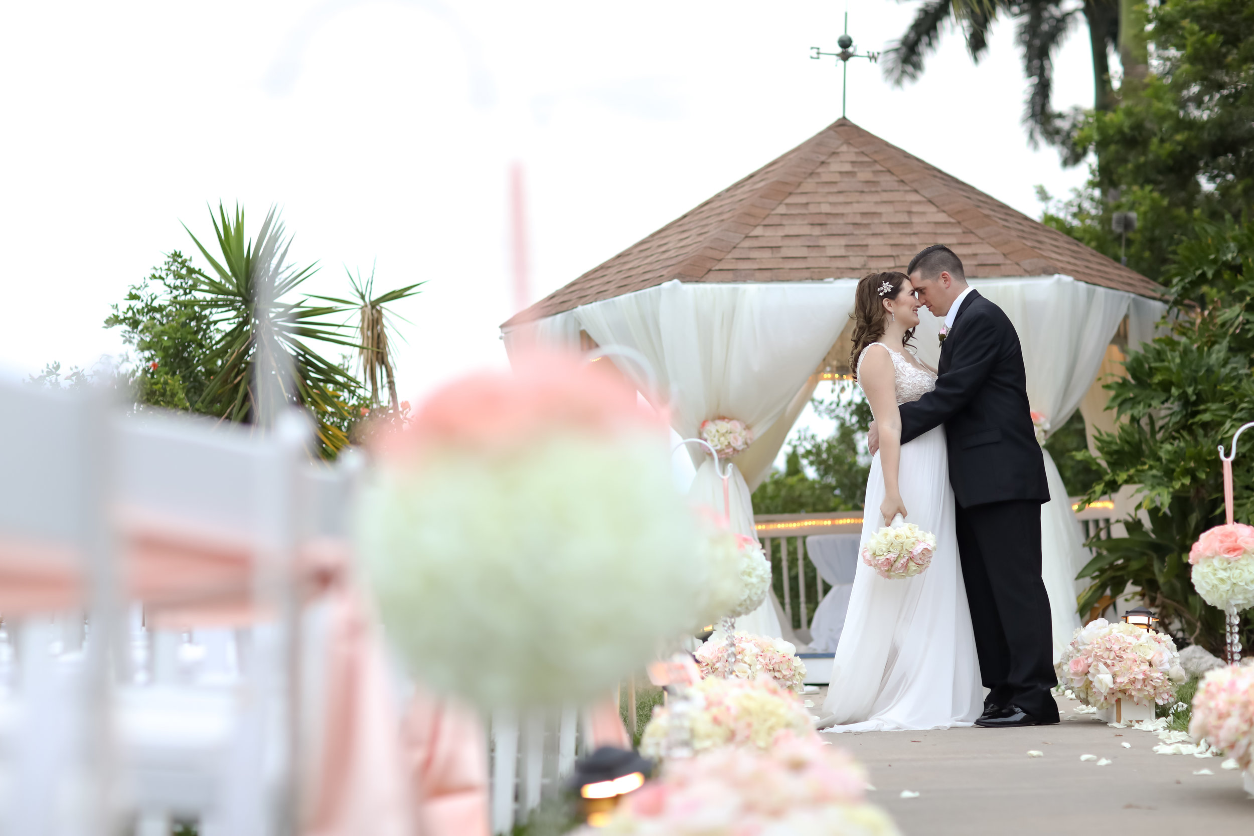Soft peach and ivory florals were in abundance for this outdoor ceremony.