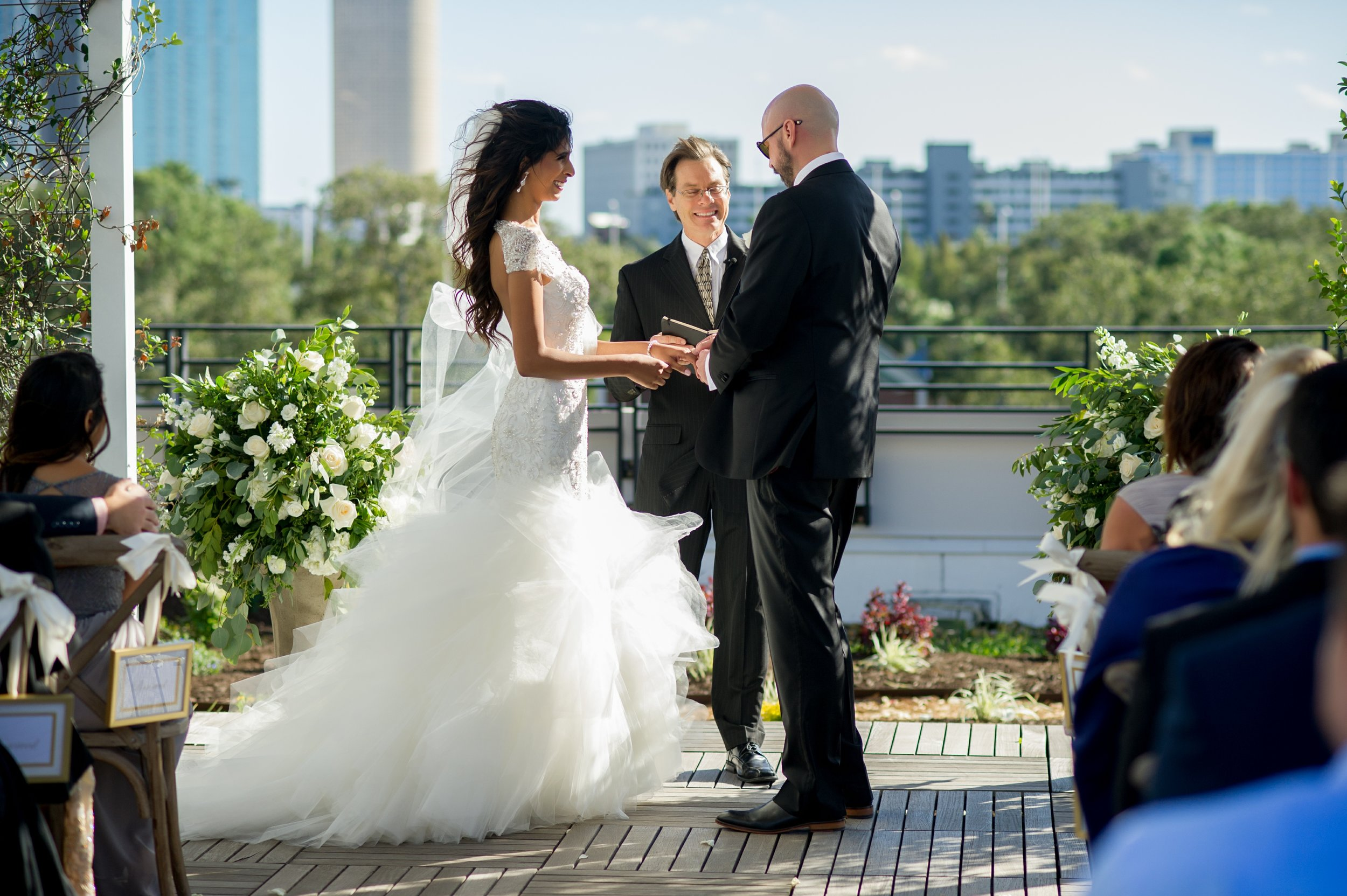 The couple exchanged vows overlooking the Hillsborough River and city skyline.