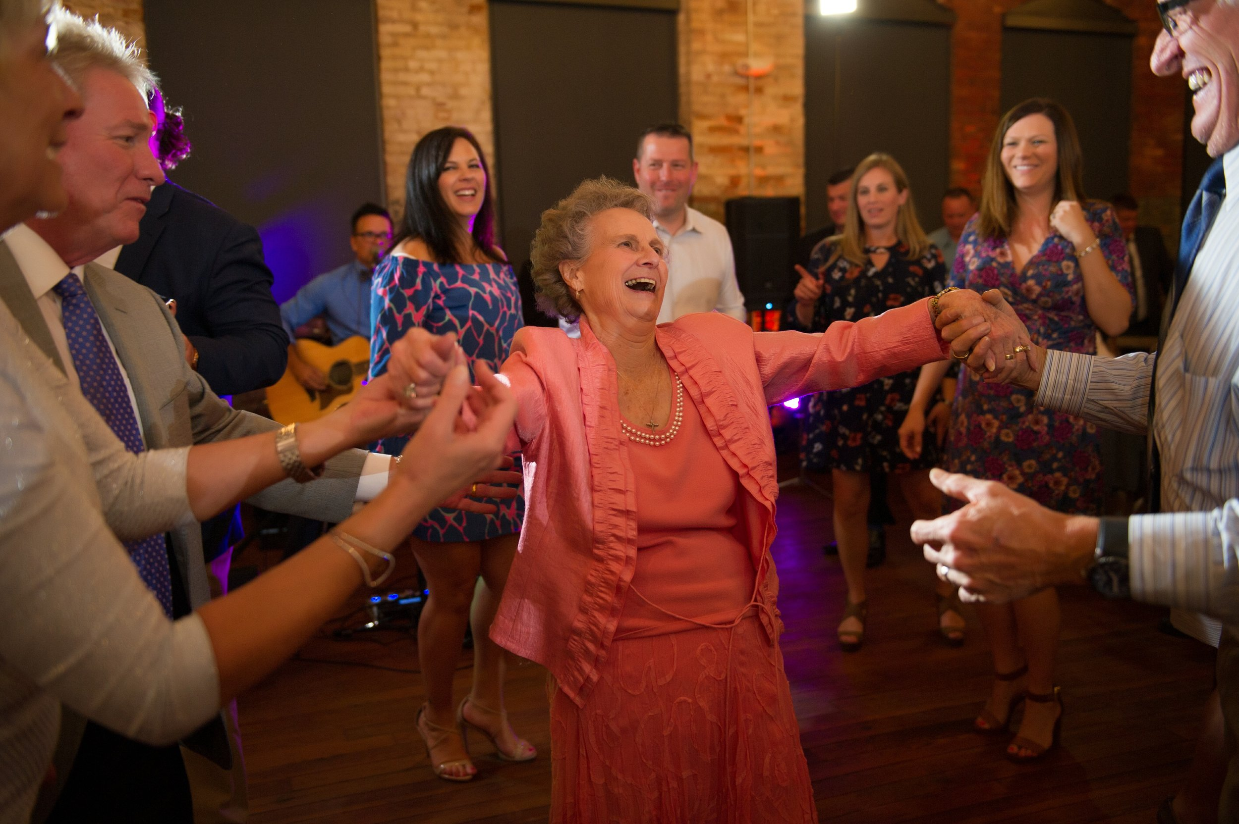 Friends and family gathered on the dance floor to celebrate the couple!