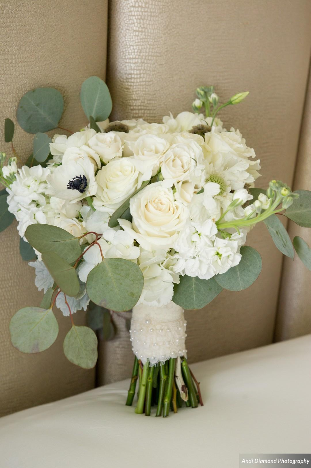 The bride's bouquet consisted of roses, hydrangea, anemones, lisianthus (in honor of the bride 'Liz'), and eucalyptus.