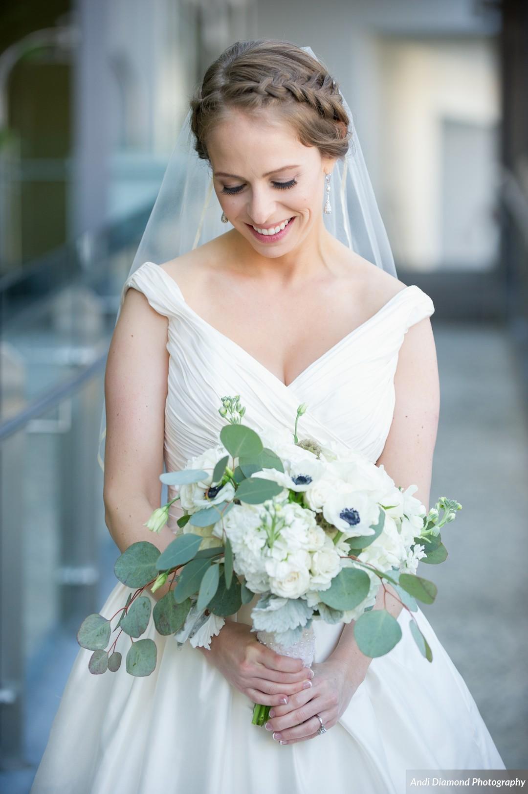 Timeless elements like this natural bouquet and the bride's mikado, slightly off-the-shoulder dress were a stunning addition to the classic details of the ceremony and reception.