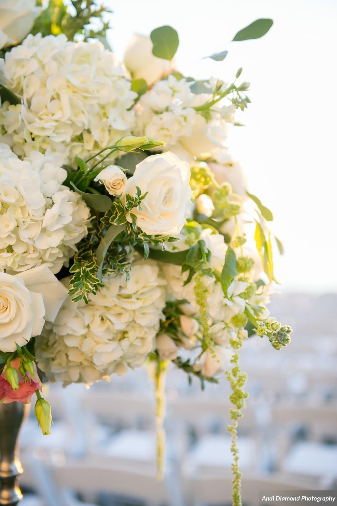 Lush arrangements of floral and greenery complimented the natural beauty of the ceremony space on Clearwater Beach.