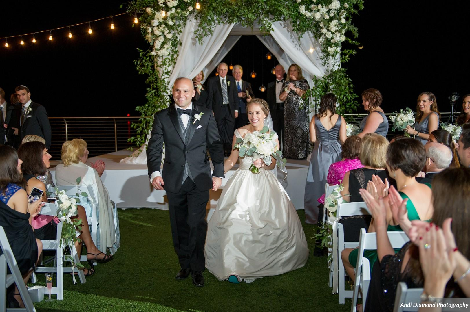 Beneath the chuppah, the couple exchanged vows in a traditional Jewish ceremony, lit by a canopy of bistro lights.