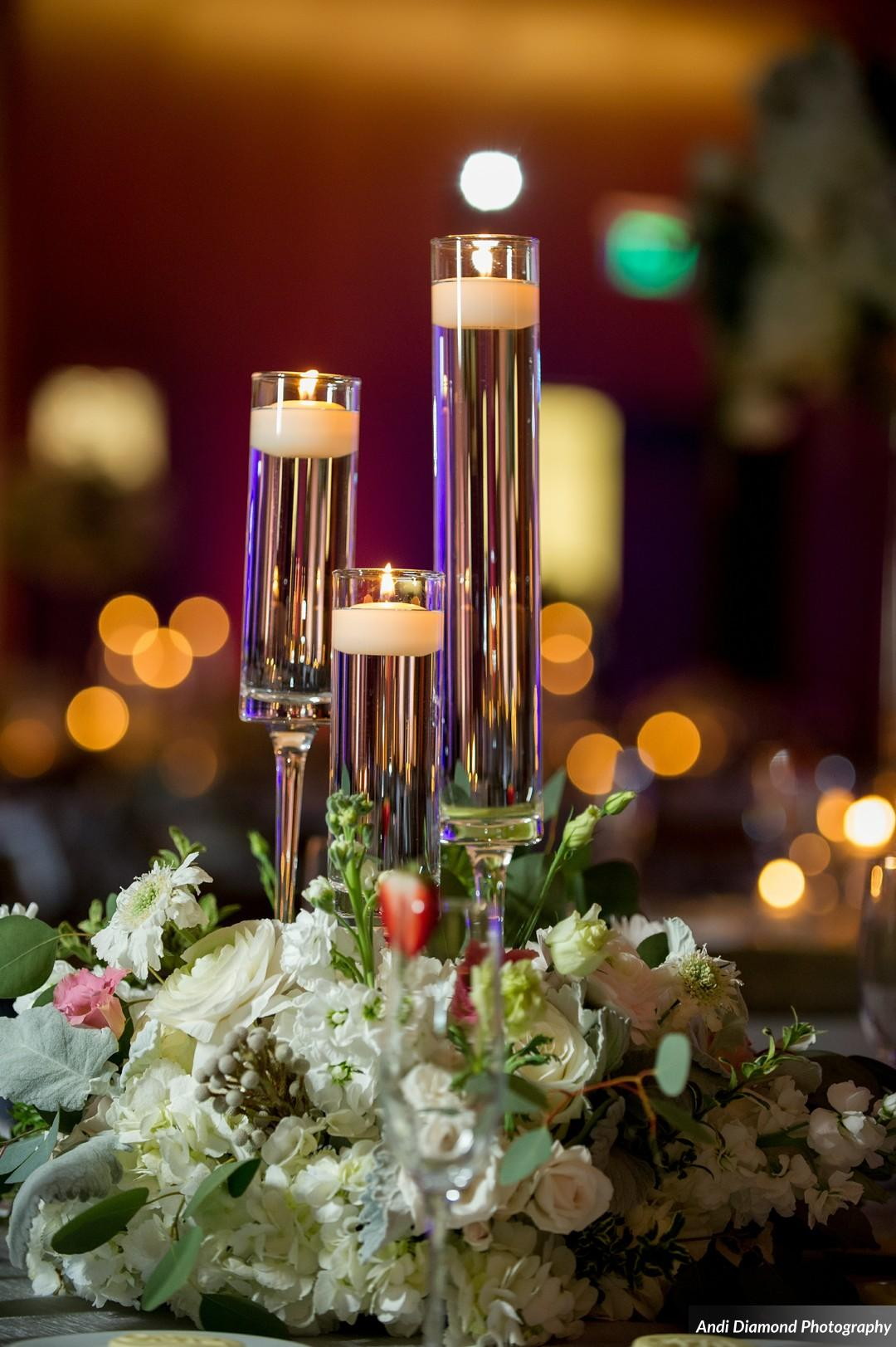 Floral arrangements included plenty of greenery for a natural element, and an abundance of candlelight for a romantic effect.