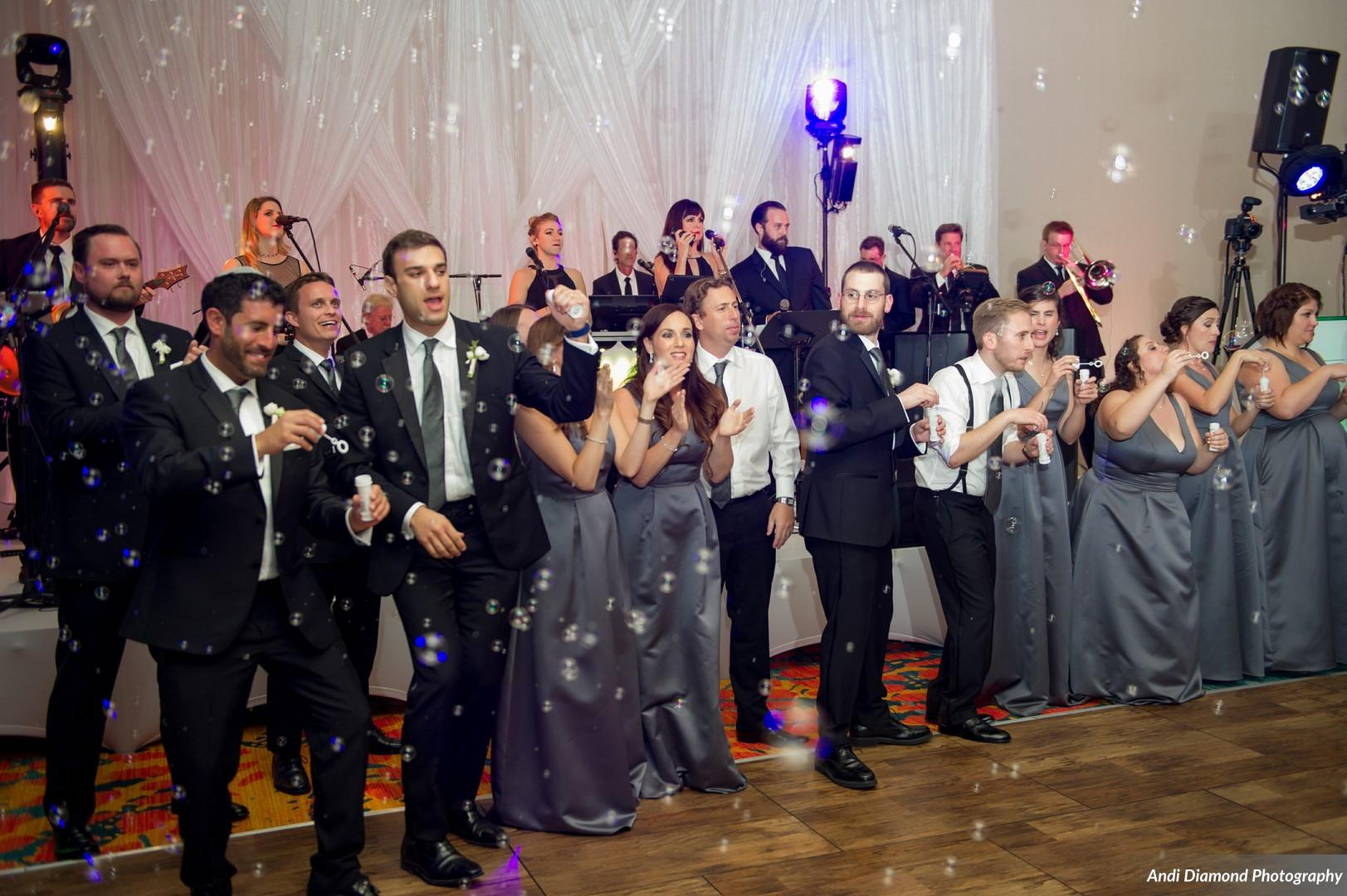 The wedding party showered the dance floor in bubbles during the first dance.