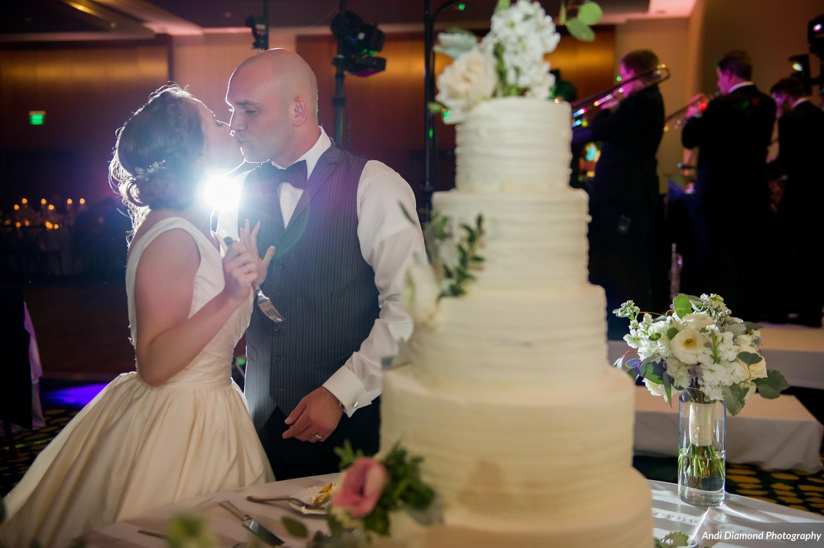 The couple shared the first piece of their gorgeous cake and a kiss!