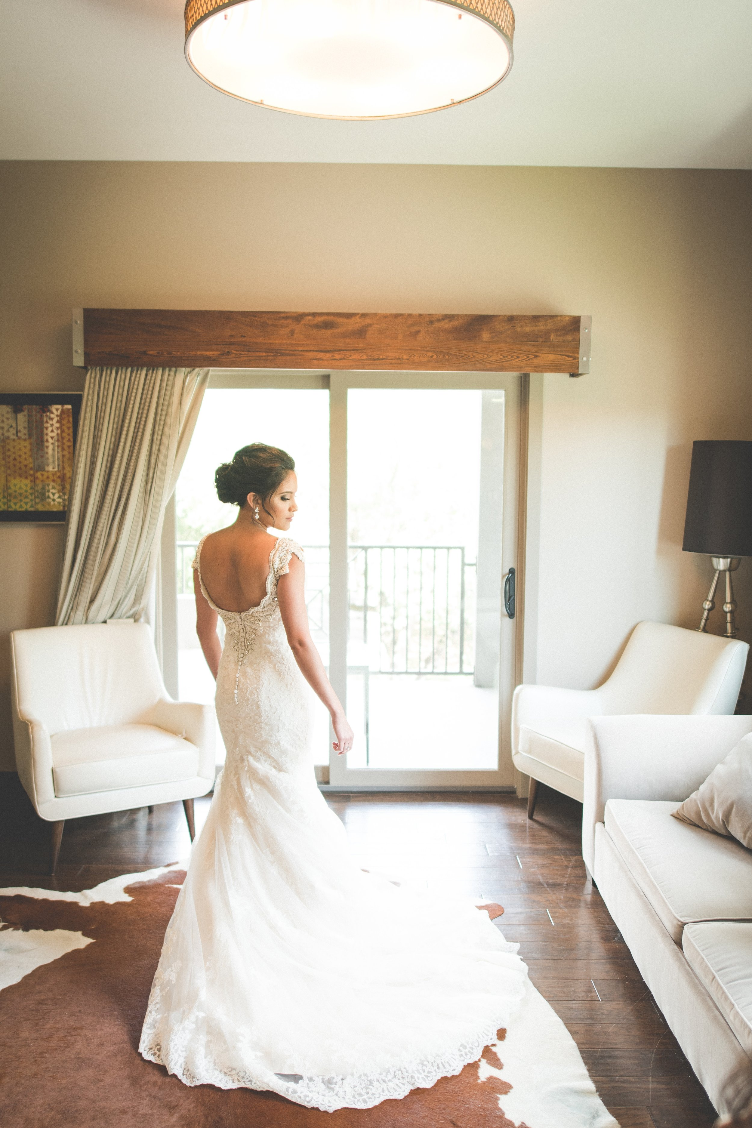 The gorgeous bride wore an ivory, mermaid style lace gown, with a plunging back and beaded cap sleeve straps.