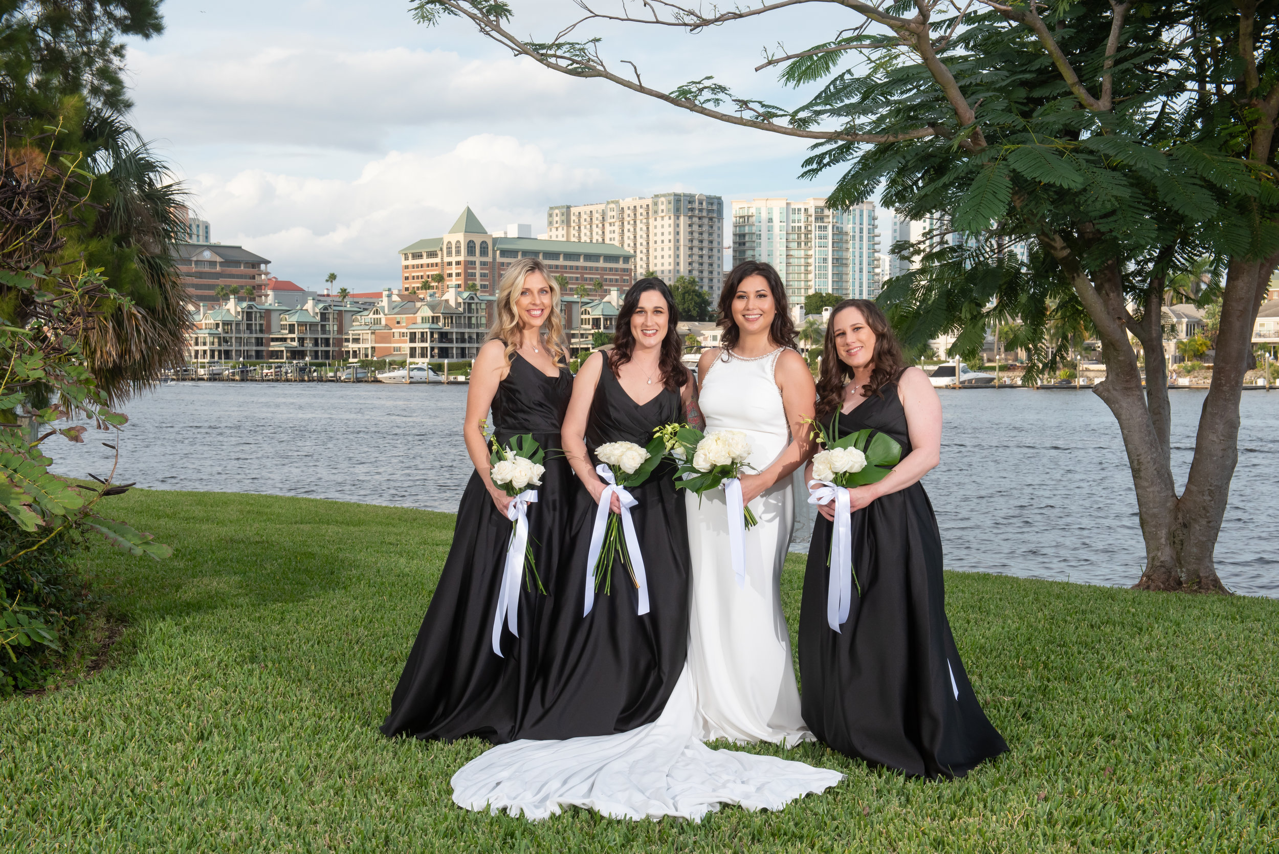 Chic white flowers and large fronds of greenery popped against the black bridesmaids dresses.