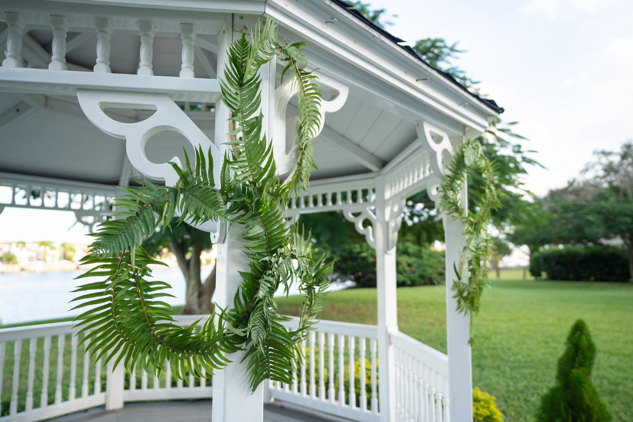 A personal touch of DIY fern frond embroidery hoops, were suspended at the ceremony gazebo.