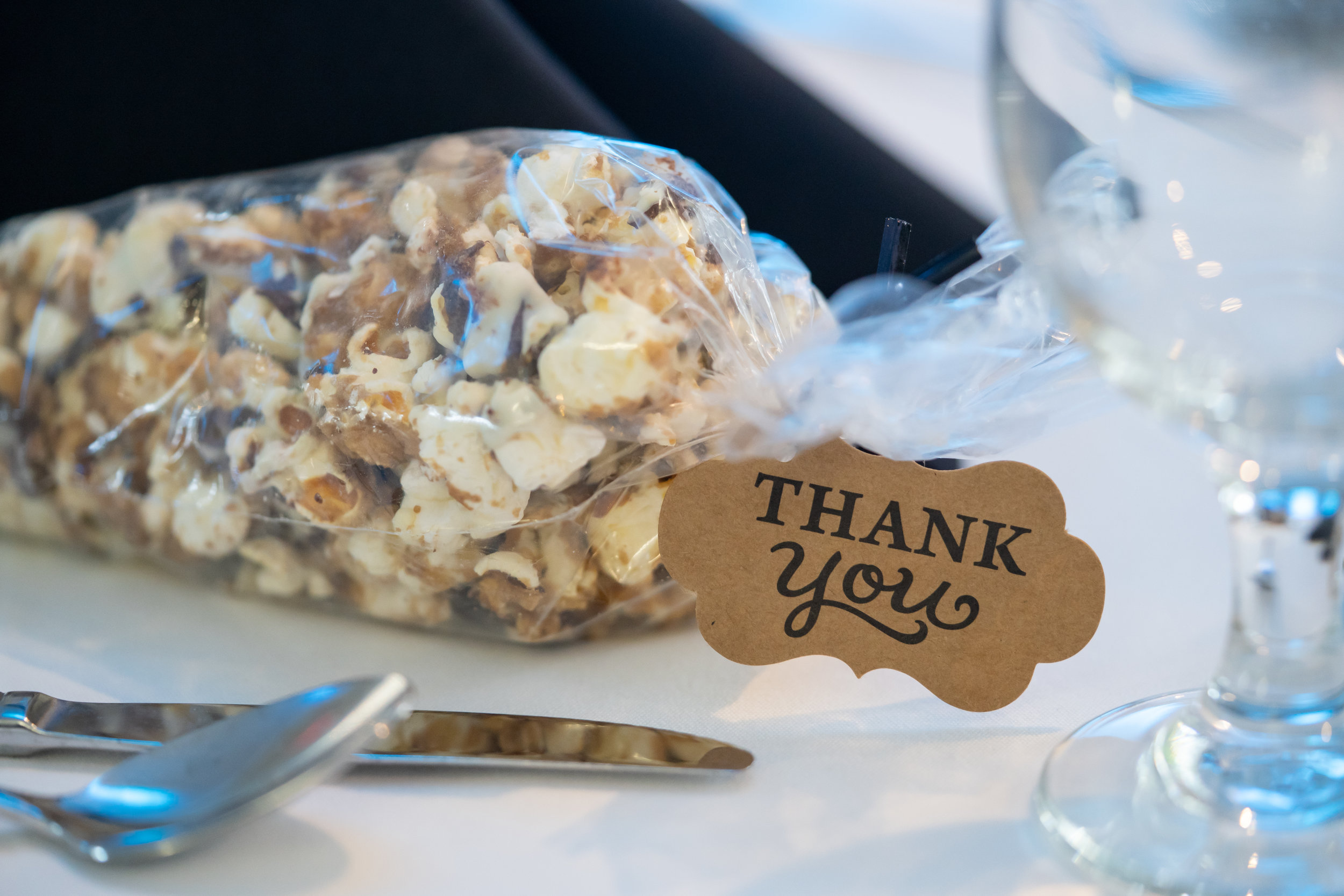 A caramel and chocolate popcorn mix (yum!) was set at each place setting as a thank you favor, and late night snack, for guests.