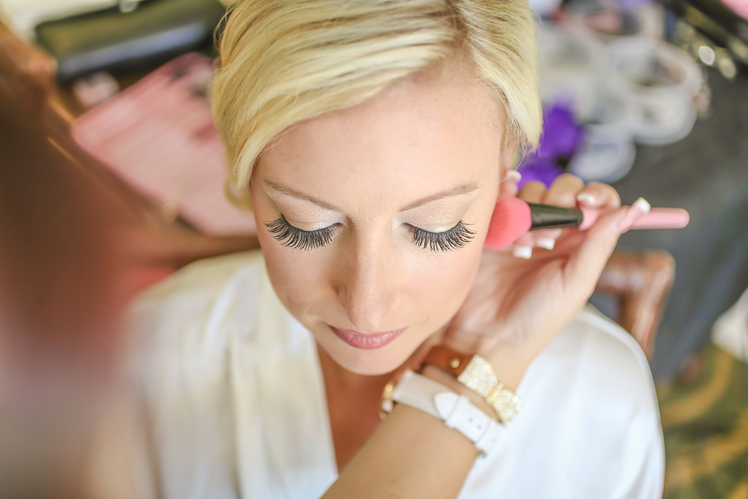 Soft yet glamorous makeup in neutral colors complimented the bride's attire.