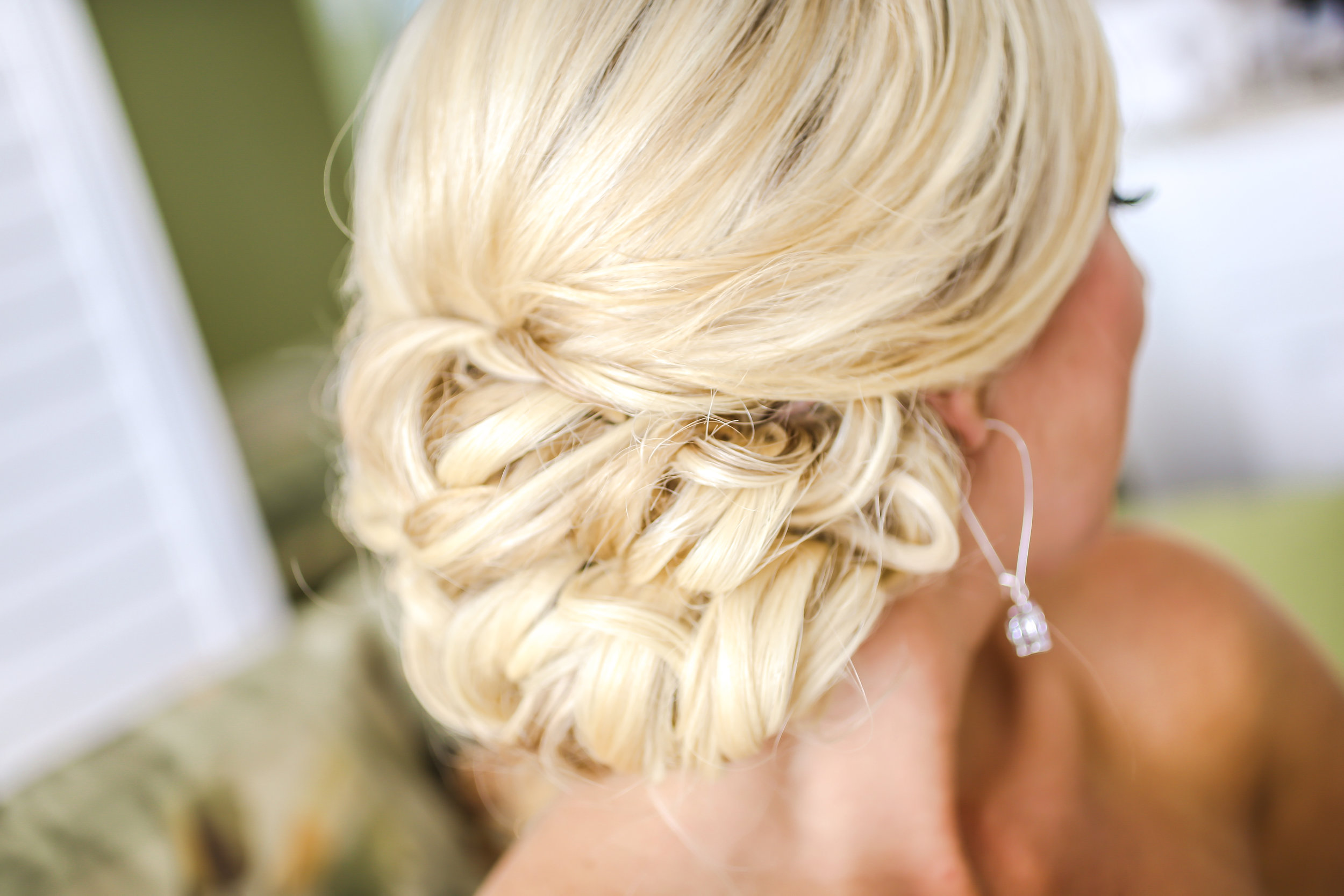To keep her hair tidy in any breezes coming in off the water the bride wore a style featuring a beautiful low updo.