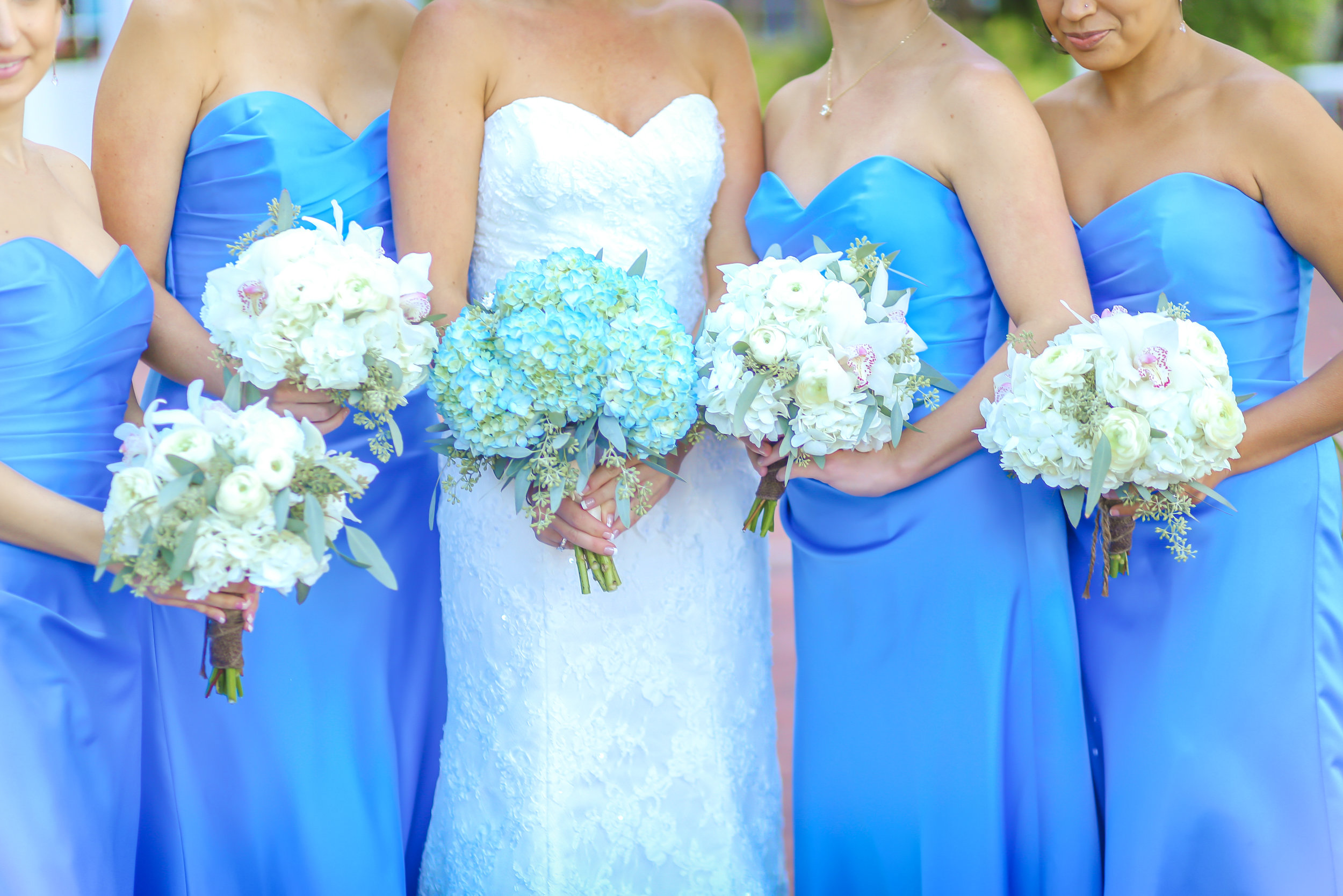 Bridesmaids popped next to the bride in their strapless azure gowns.