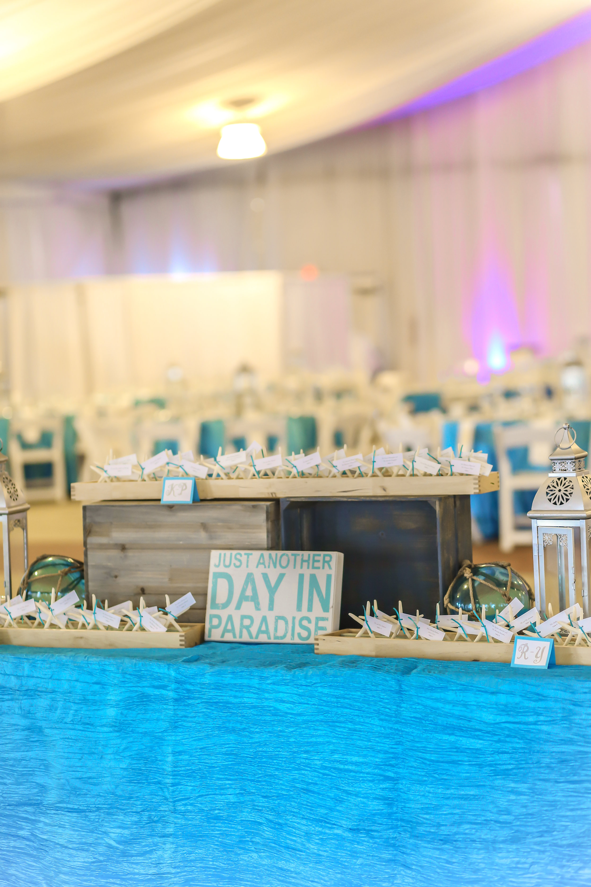Nautical details and lanterns decorated the escort card display table.