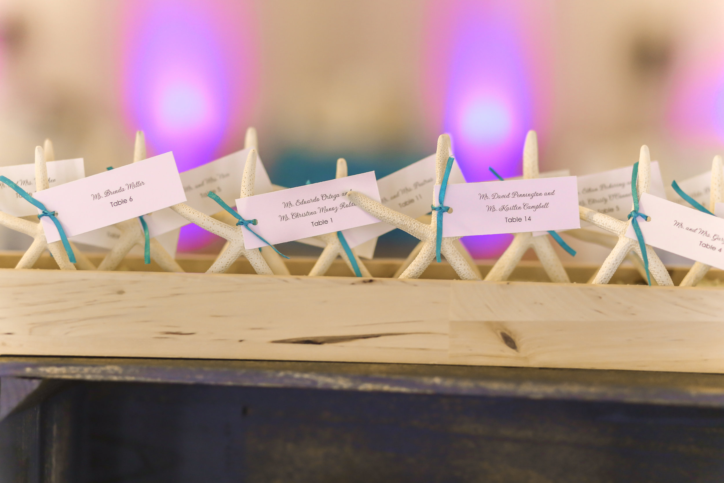 Starfish escort cards sat perched in delicate wood boxes.