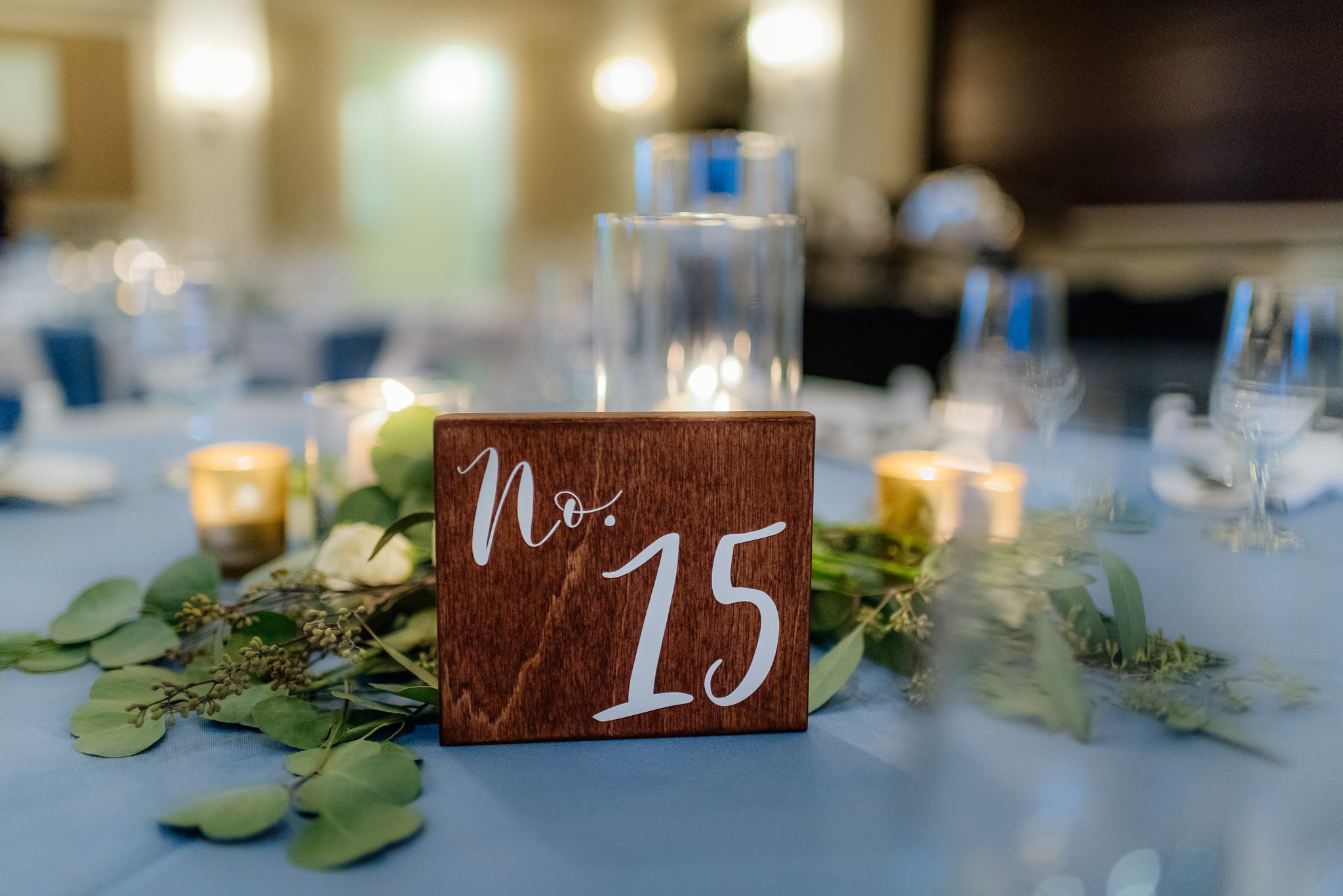 winsor event studio greenery centerpiece wood table number