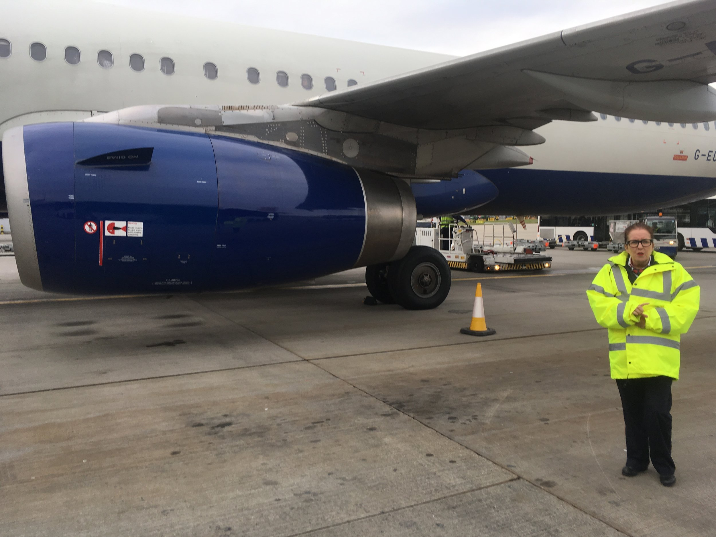 BA aircraft arrived at a domestic gate, requiring bus transportation to an international gate.