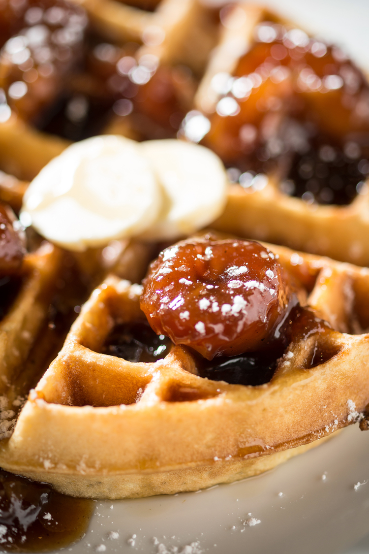 belgian waffles with sweet butter and roasted banana
