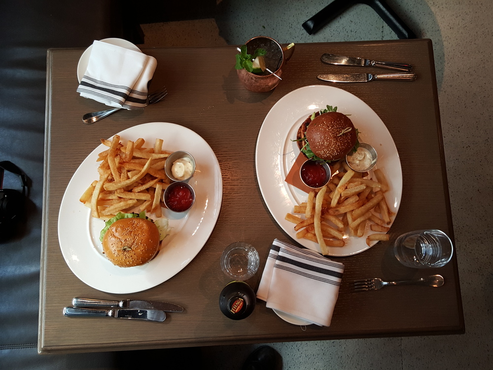 set table with two cheeseburgers and fries