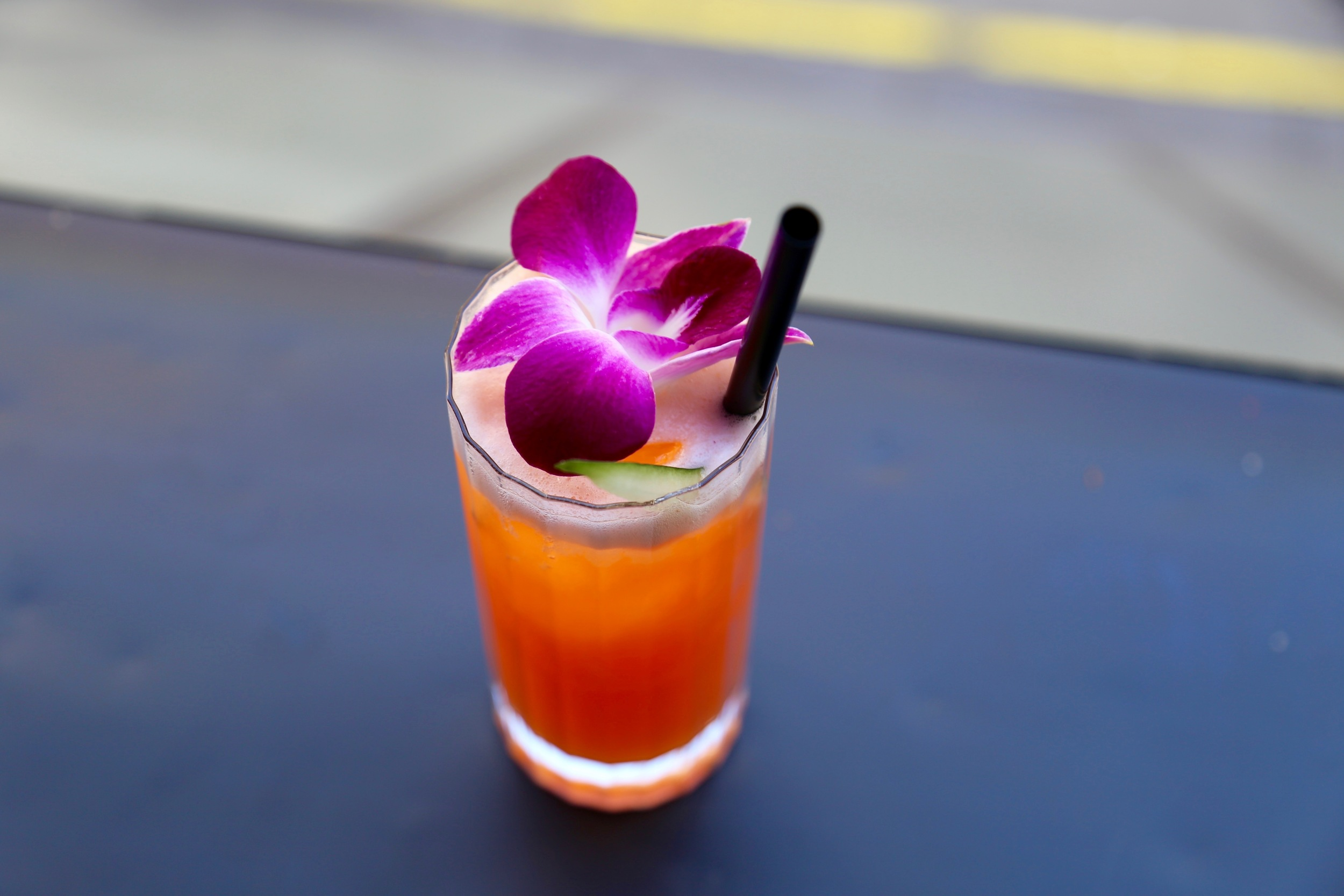 orange cocktail with orchid