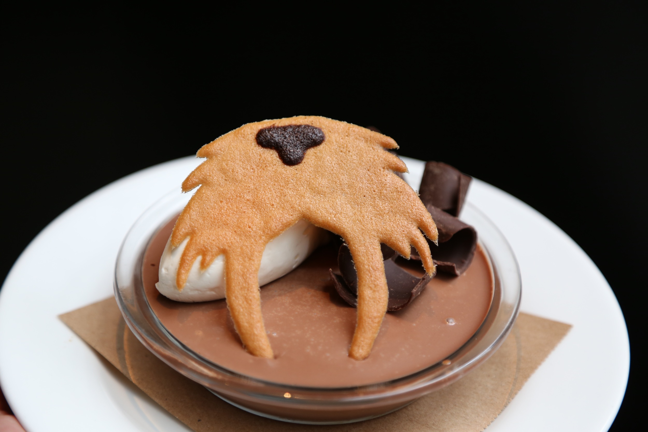 chocolate mousse dessert with walrus cookie