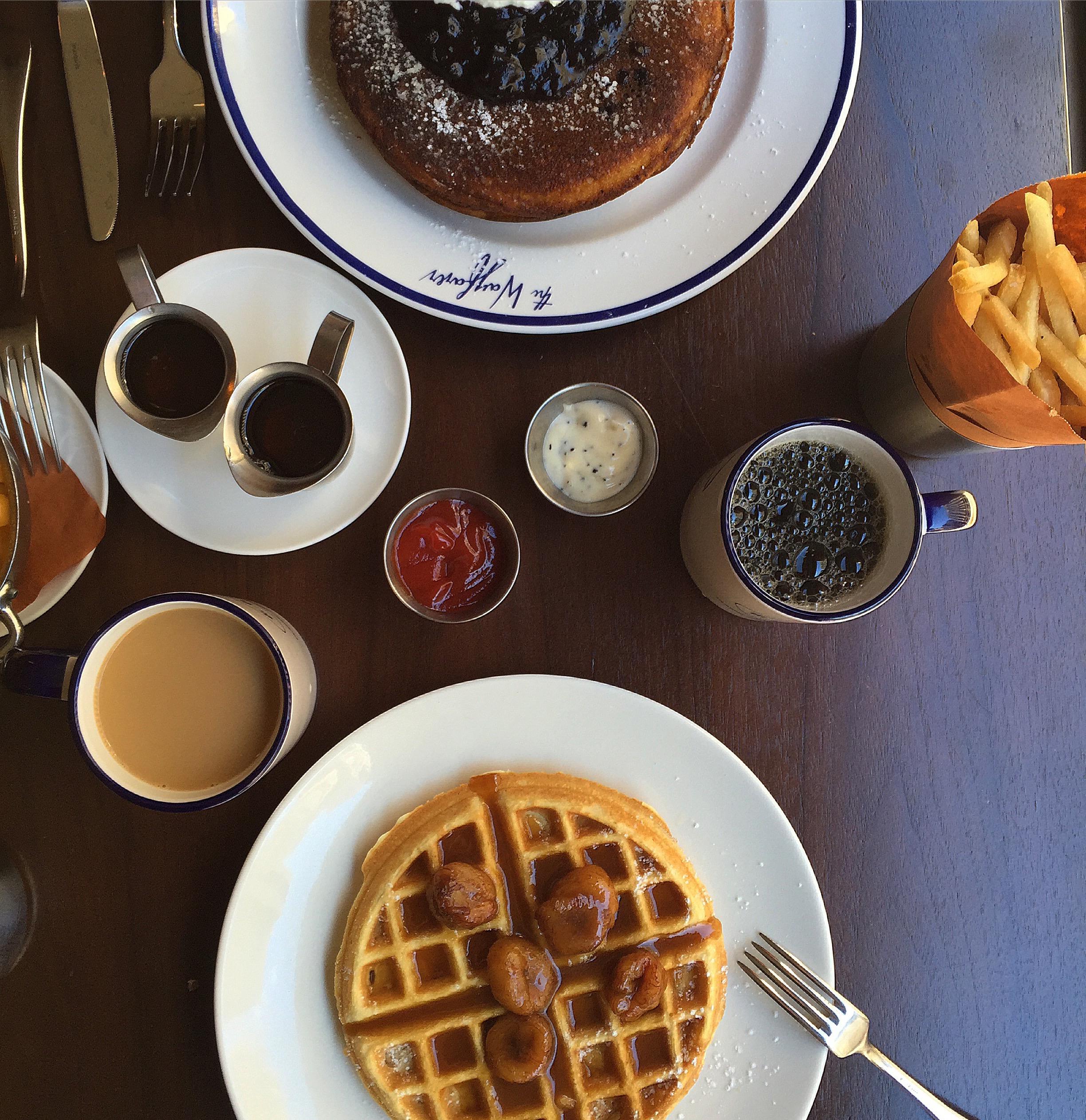 aerial shot of table with buttermilk pancakes and belgian waffle