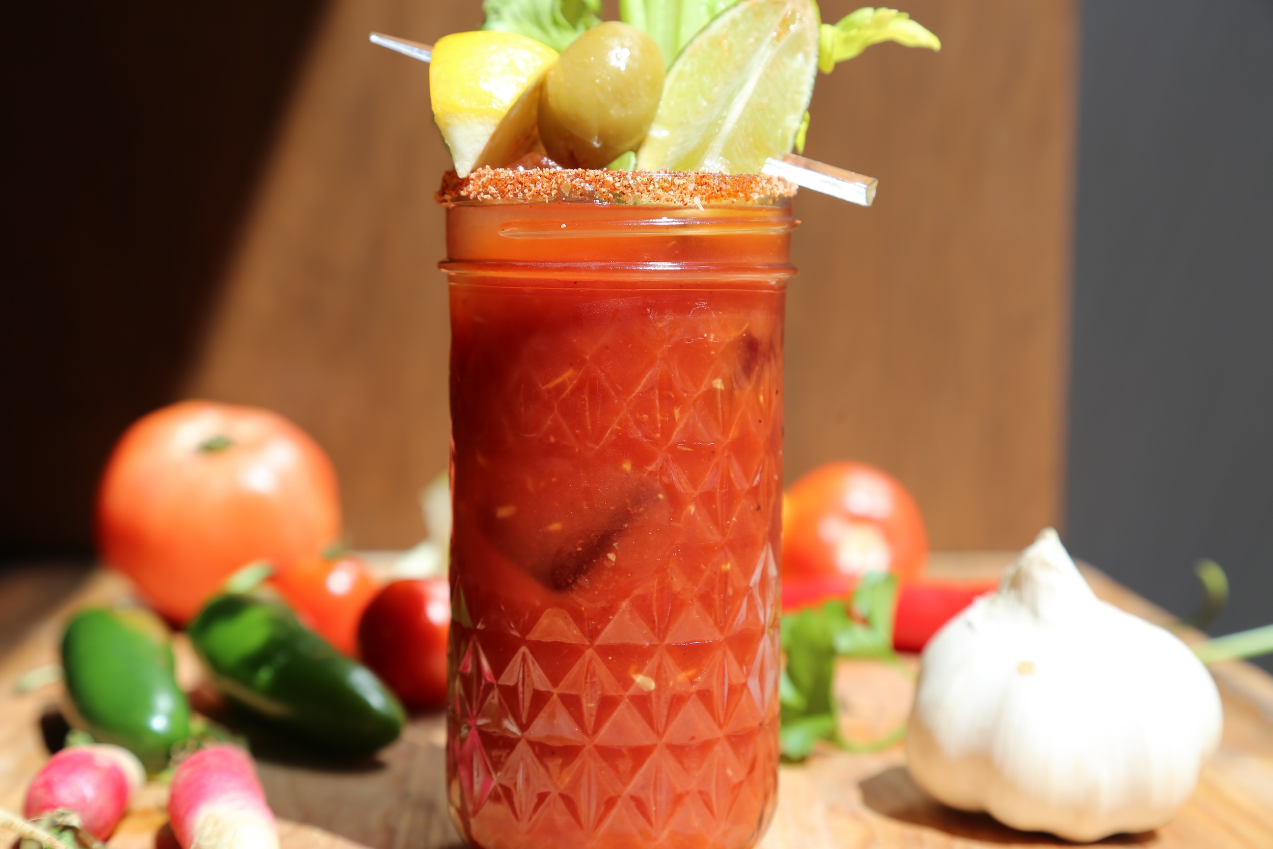 bloody mary with vegetables on table
