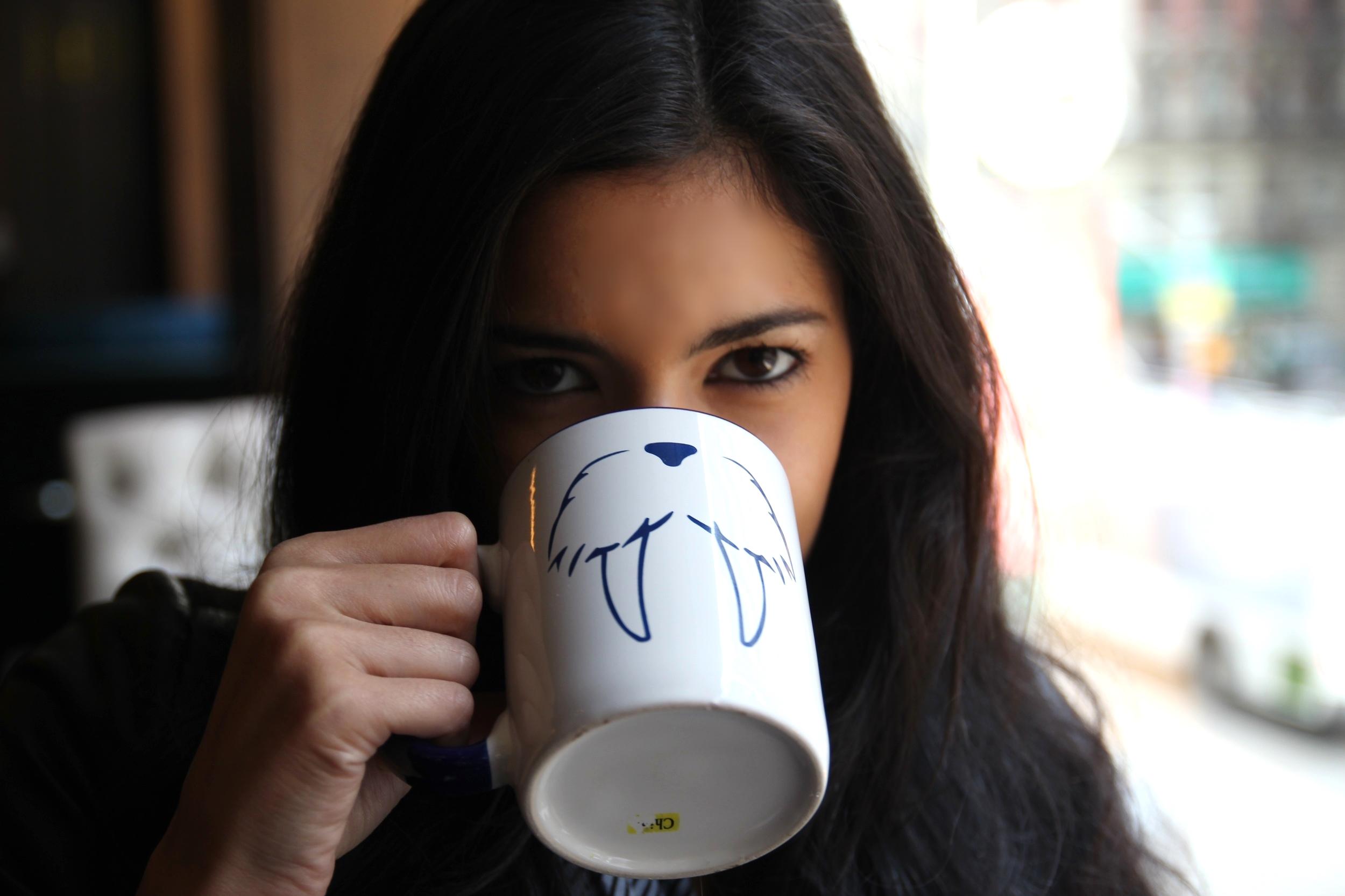 girl drinking out of mug