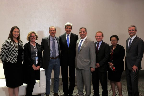 Mike Howard, Smith's executive vice president for finance and administration (5th from left) with former U.S. Secretary of State John Kerry and other participants at a recent climate action summit.