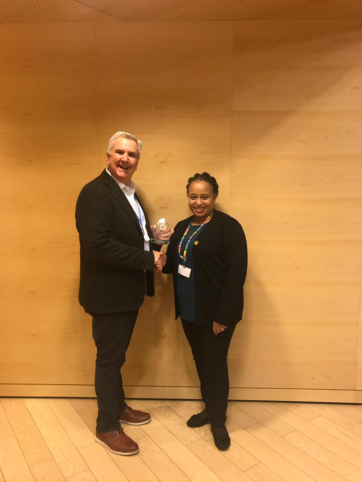 IETA CEO Dirk Forrister presents the Carbon Pricing Champion award to Angela Churie Kallhauge, Head of the CPLC Secretariat.