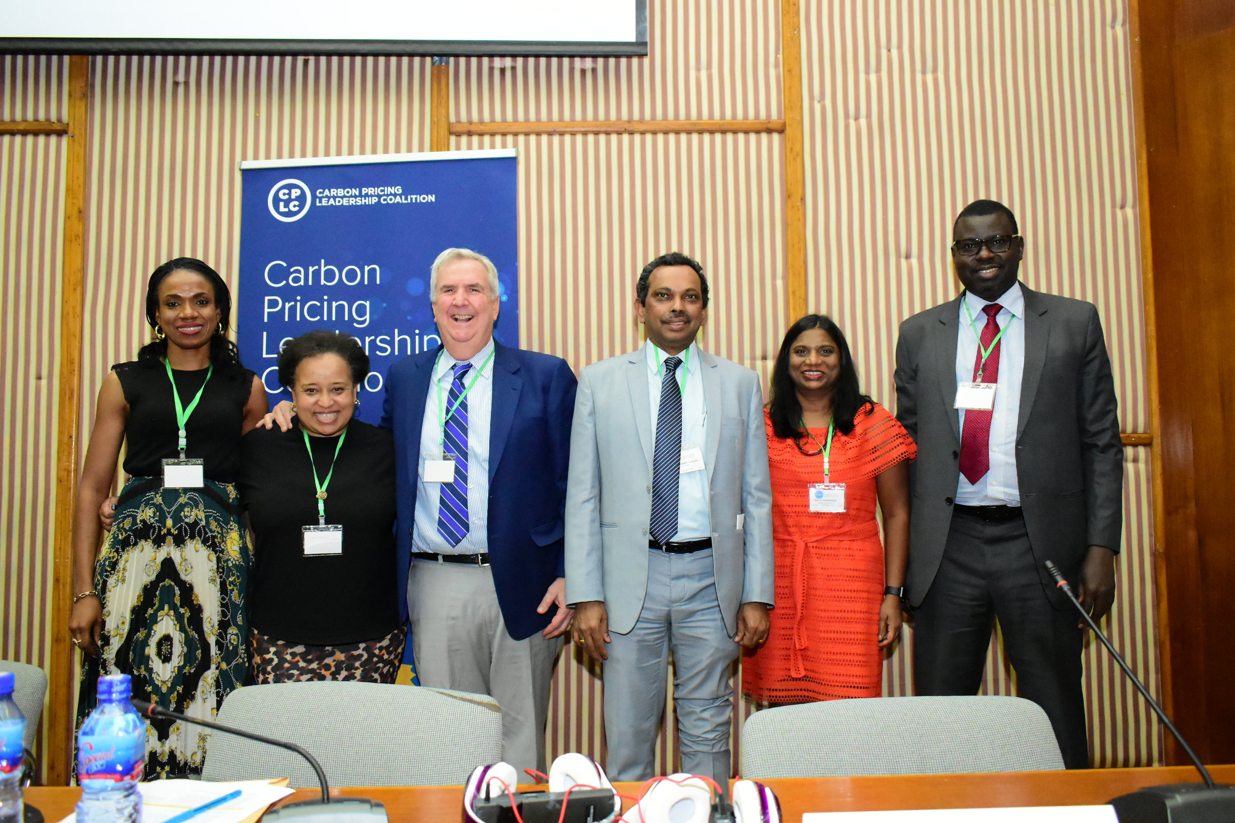 Panelists take a photo after the closing session and final remarks