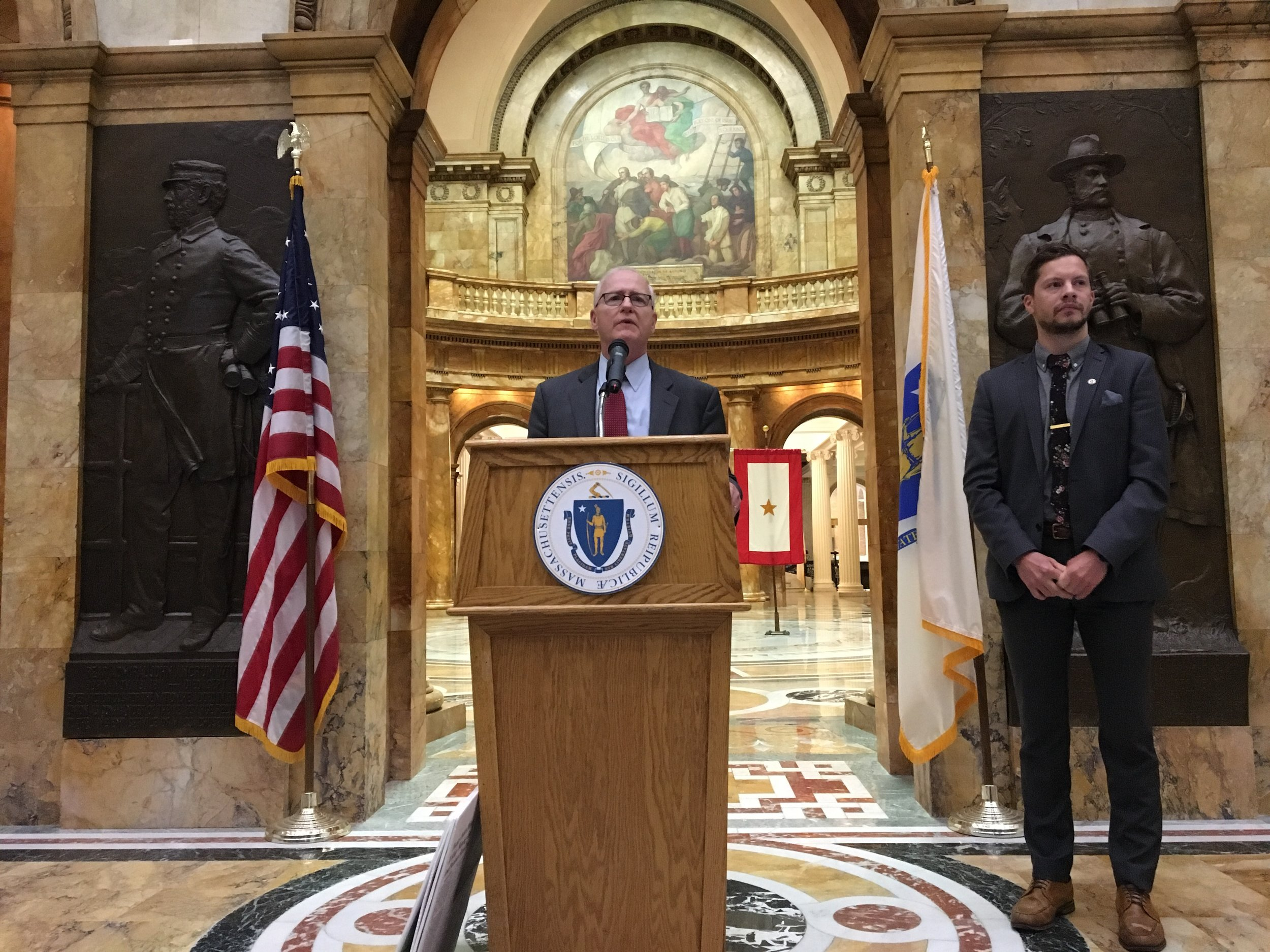 Senator Michael Barrett (D-Third Middlesex) with ClimateXChange Executive Director, Michael Green speaking about carbon pricing at the Massachusetts State House.