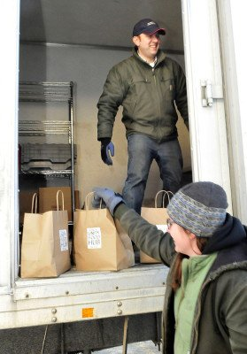 Photo: Matt Tremblay,  unloads boxes and bags of food as Colleen Hanlon-Smith, Product, Sales & Marketing Manager brings the Community Supported Agriculture food shares inside for employees at Johnny's Selected Seeds business office in Fairfield.    Staff photo by David Leaming.