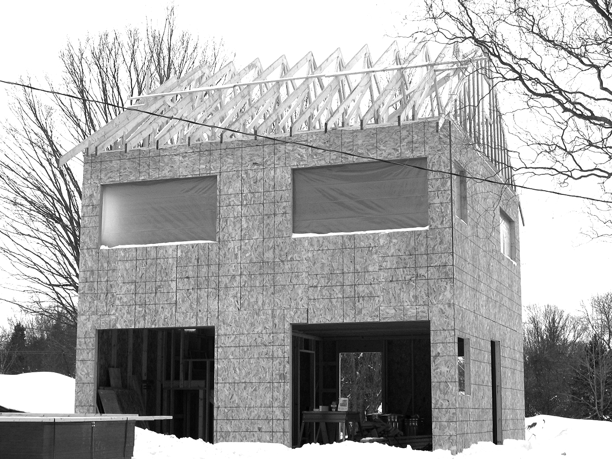 - NewenHouse is cost effective because the framing sequence is simple and the materials common.In the first phase the cube is constructed like a standard platform-framed house with flat roof using 2x4 wood structural walls with osb sheathing and 2x10 roof joists with plywood roof deck. The osb and plywood create the airtight layer and all seams are taped. Roof trusses with energy heel are installed. This basic structural enclosure is made very quickly, with minimal instruction required and with components from the local lumberyard. All mechanical and electrical are installed in the 2x4 walls and do not penetrate the airtight sheathing.The next phase is the installation of the 12 inch larsen truss using scrap 2x4 and plywood material.