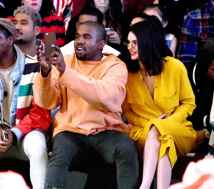Kanye and Kendall show their support sitting front row at the GOLF fashion show. (GQ.com)