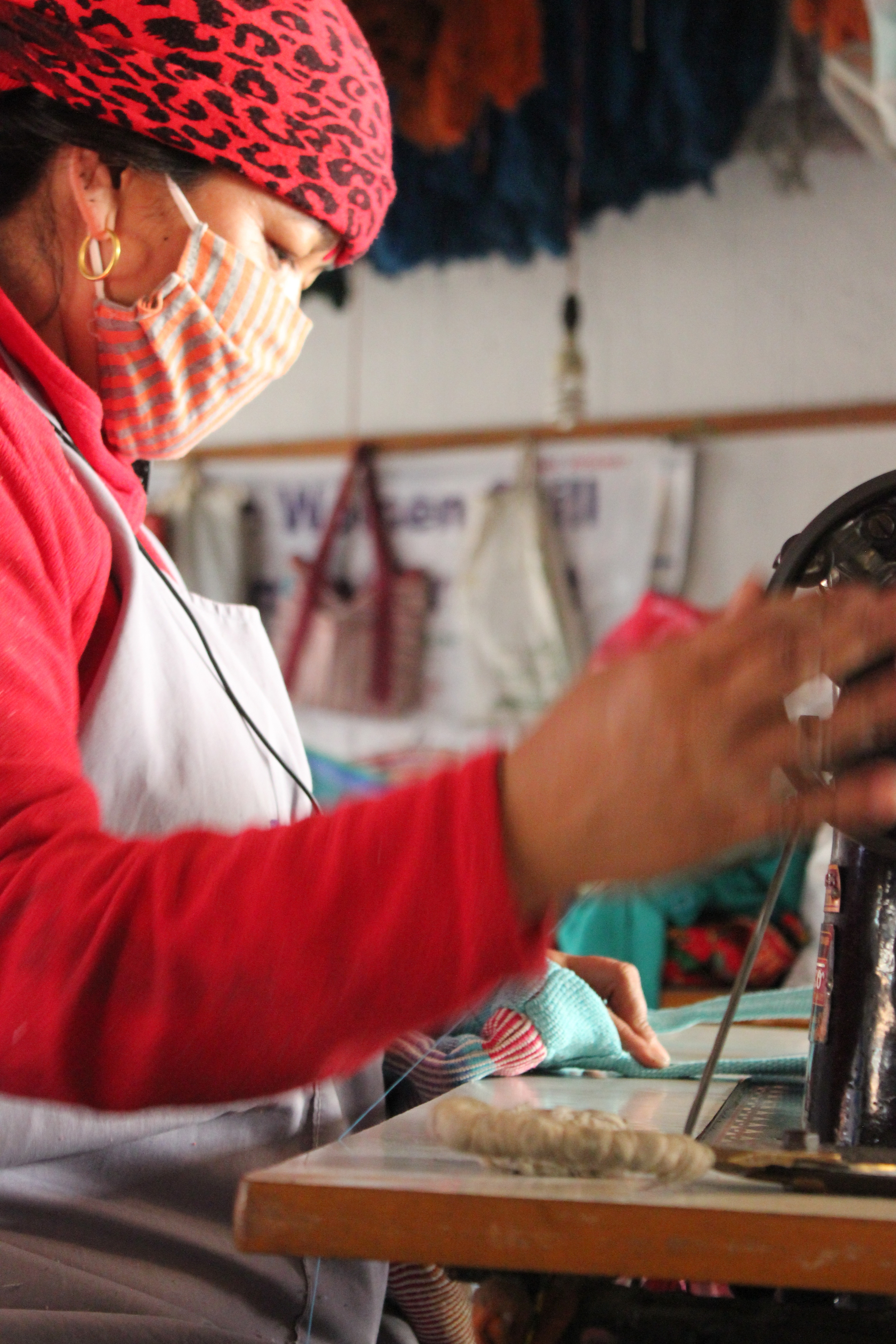Sita working at the sowing machine in Nepal.
