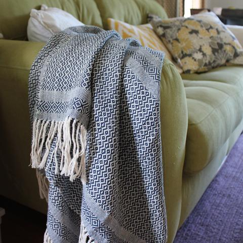 Living Threads Co. - Handwoven Throw $95   Handmade artisan designed and woven 100% cotton throw in Birds Eye weave. Available in a variety of Eco-dyed colors. Purchase supports artisans and their families as well as the preservation of traditional weaving.