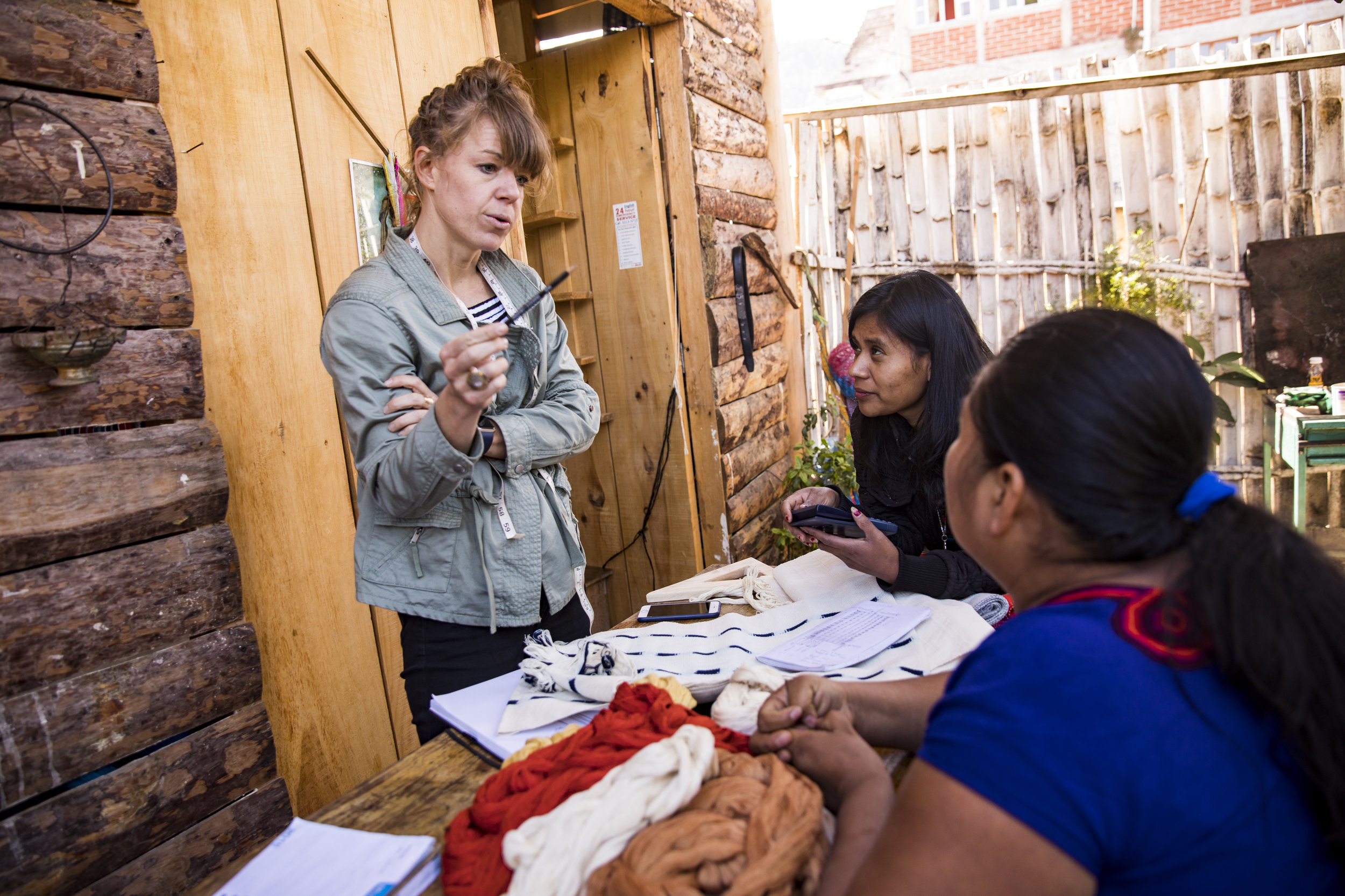 Founder Amanda works with artisans Amalia and Blanca on a new napkin design. Stay tuned!