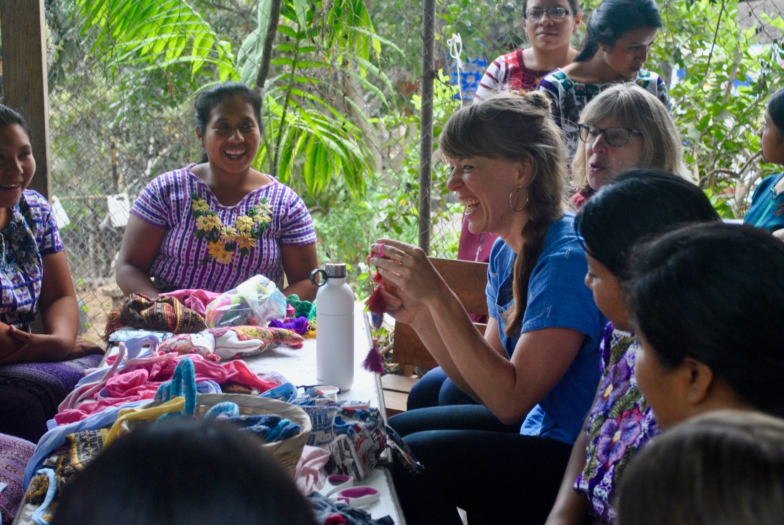 Amanda Zehner (Founder & CEO) sitting down with the Mother Artisan Group at La Puerta Abierta Learning Center.