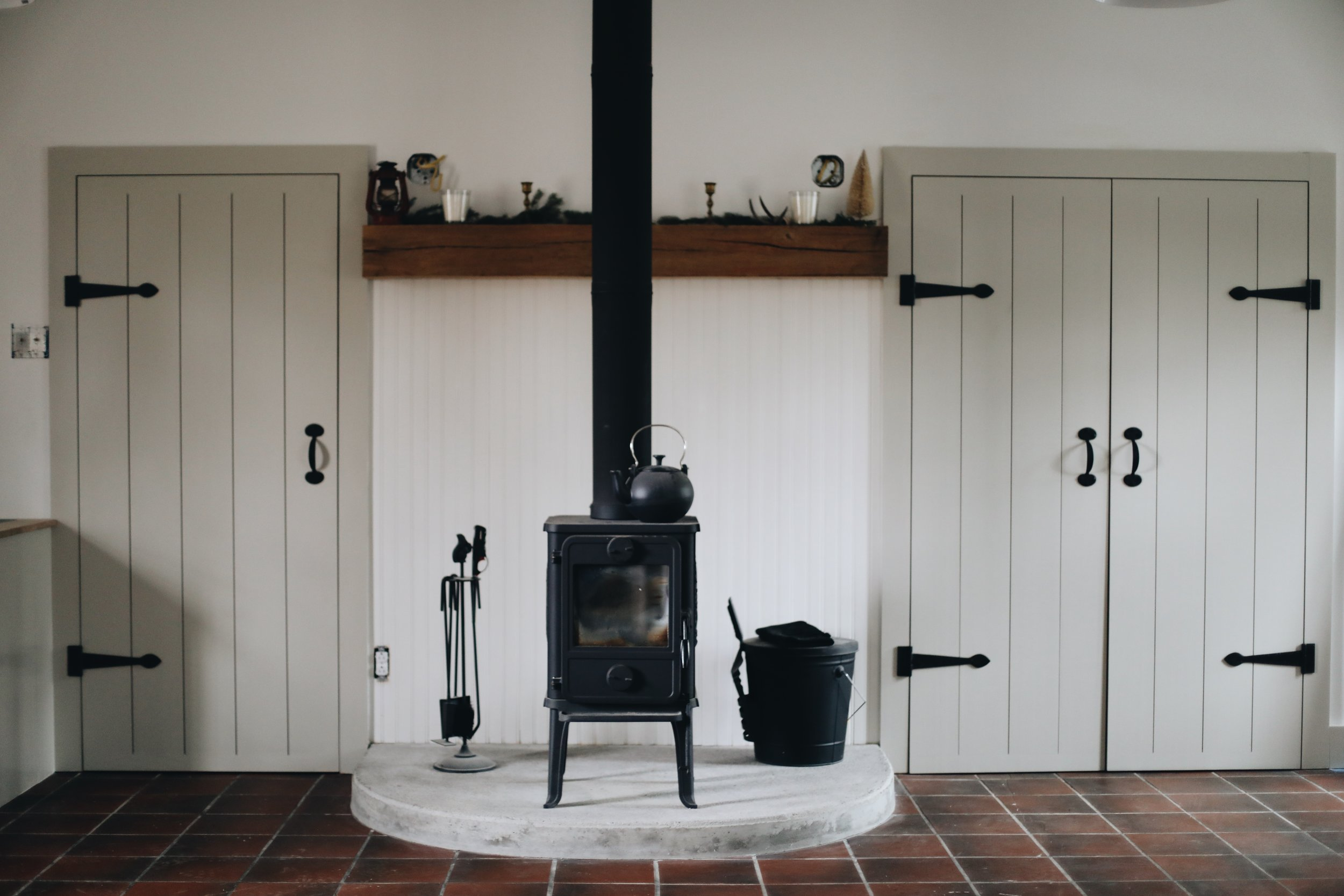 a little danish squirrel stove by morso, custom cottage-style doors by our friend + contractor sam koch.